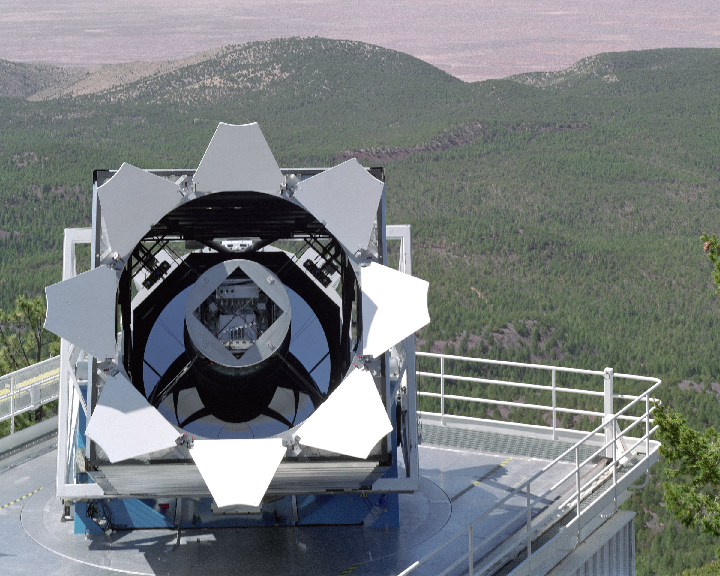 The Sloan Digital Sky Survey telescope at the Apache Point Observatory stands out against New Mexico's Sacramento Mountains. Five years after the University of Utah joined the survey's third phase, it announced it is joining the fourth phase of the international effort to map the heavens on three size scales. The Willard L. Eccles Charitable Foundation and the university will split the $700,000 cost.