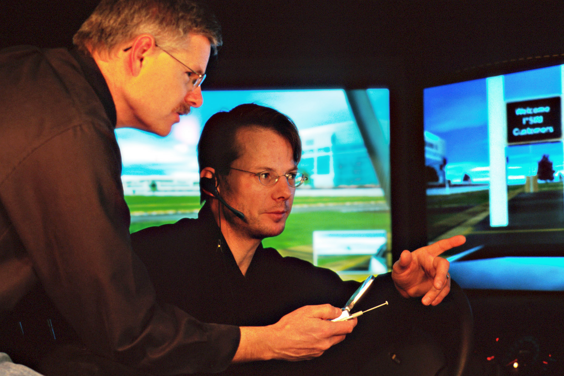 U psychologists David Strayer (left) and Frank Drews in driver simulator in laboratory.