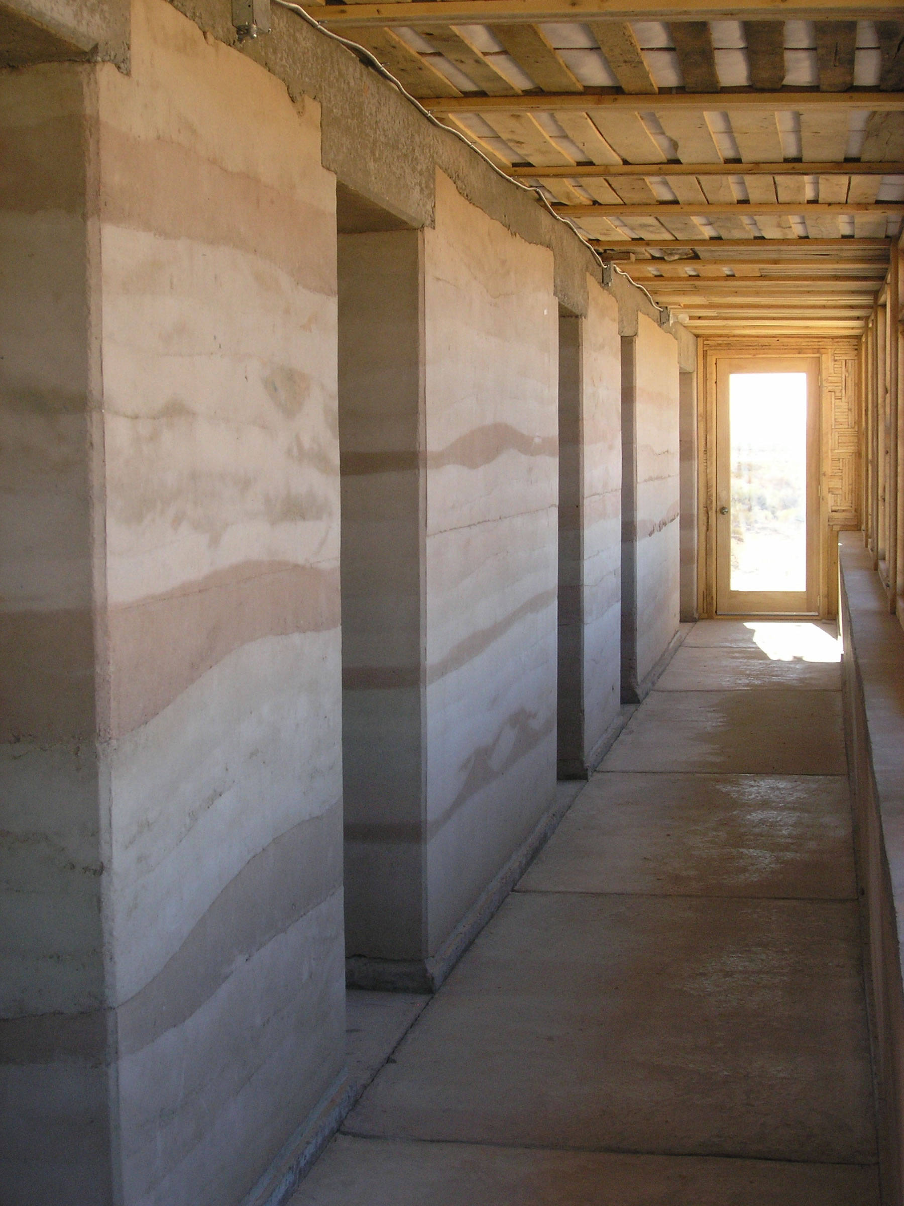 Rammed earth walls are comprised of compressed sand and clay dug and sifted onsite.