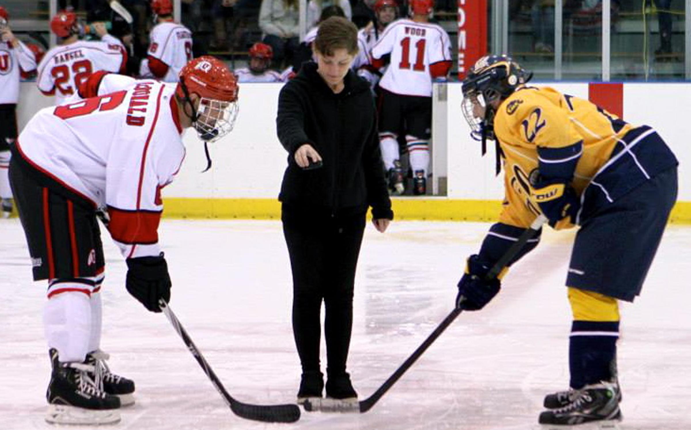 University of Utah student Annika Pecchia-Bekkum, a Gates Cambridge Scholar for 2014, shown receiving another honor--dropping the puck at a Utah vs. UC Berkeley hockey game.