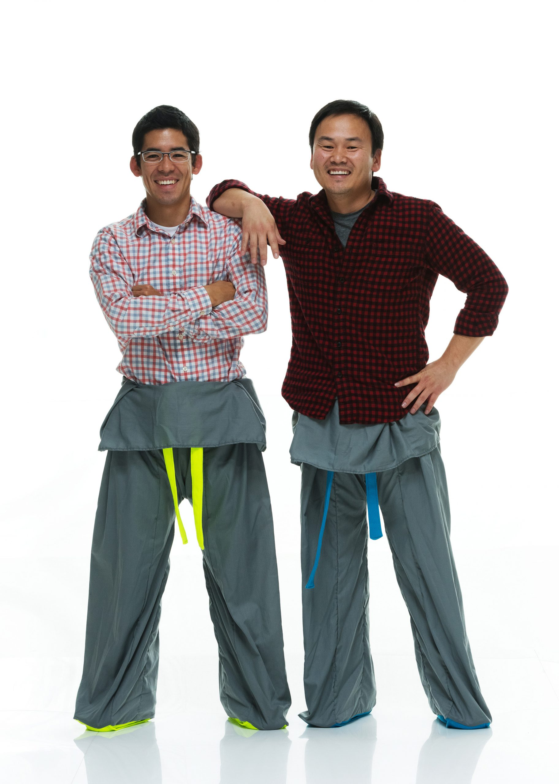 """University of Utah students Brayden Iwasaki (left) and Garred Lentz (right) came up with the idea for Sakpants, a cross between """"Thai fisherman pants"""" and children's footie pajamas, in 2013. They developed an initial prototype and received a $3,000 seed grant from a U program affiliated with the Lassonde Entrepreneur Institute. The students used the seed money to refine their product and then raised nearly $25,000 from 476 supporters on Kickstarter.com to continue moving their idea to production."""