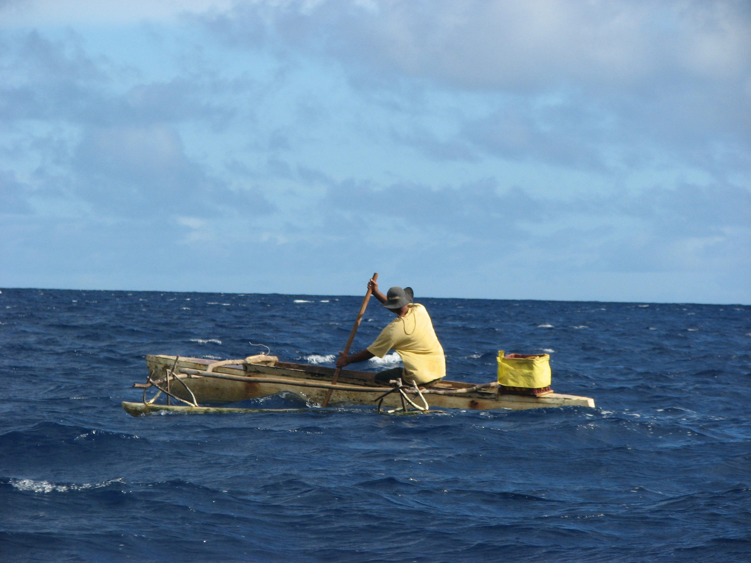 A canoeist paddles between the islands of Vava'u, Tonga. A new University of Utah study uses mathematical modeling to get a better idea of the strategies employed by early seafarers when they used outrigger canoes to settle the islands of the vast Pacific Ocean between 3,500 and 900 years ago.