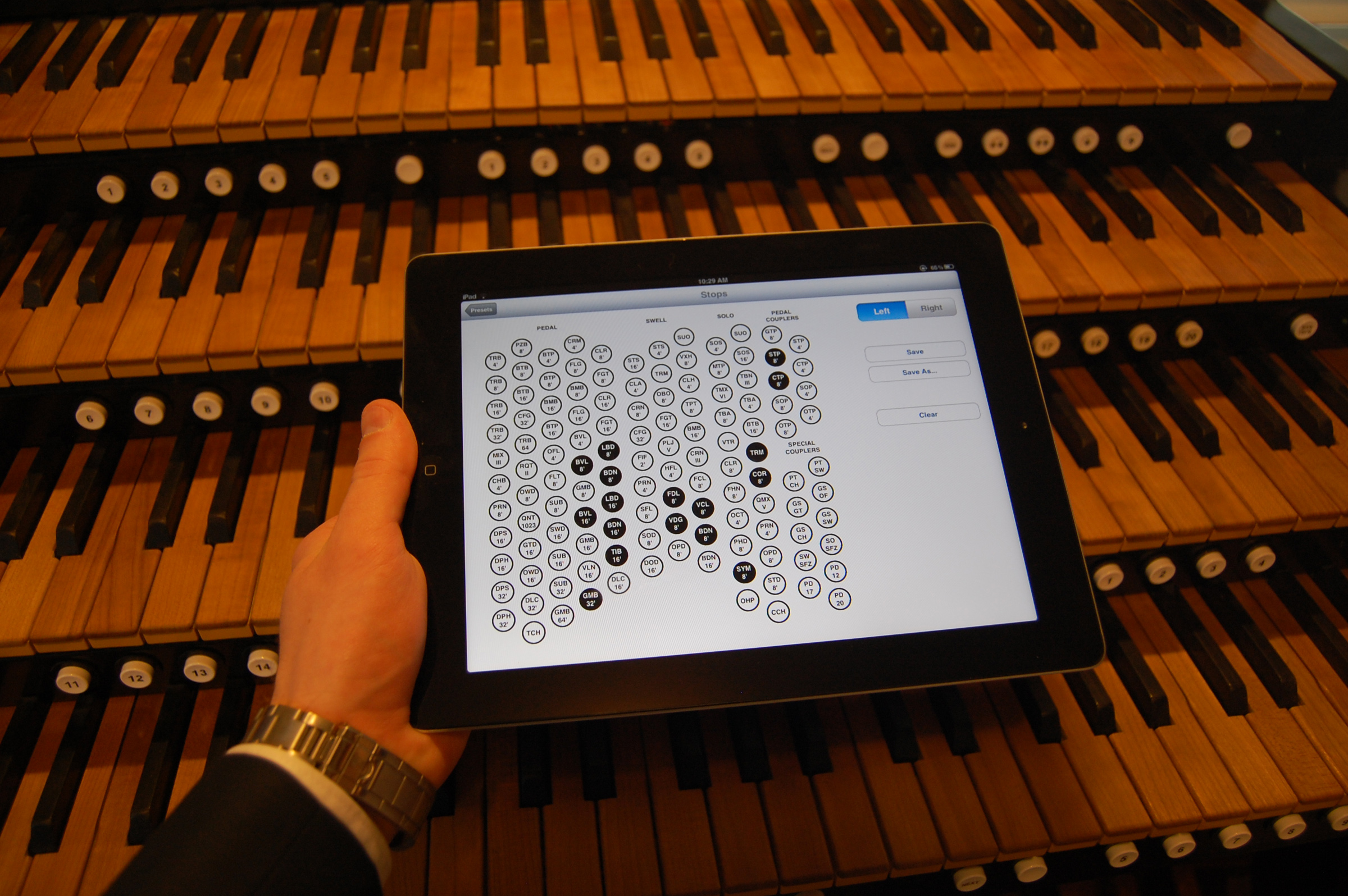 """University of Utah computer science student Rob Stefanussen holds an iPad displaying an """"app"""" he developed to record the settings on church pipe organs. It is among about 30 apps developed by students in a class on iPhone and iPad programming."""