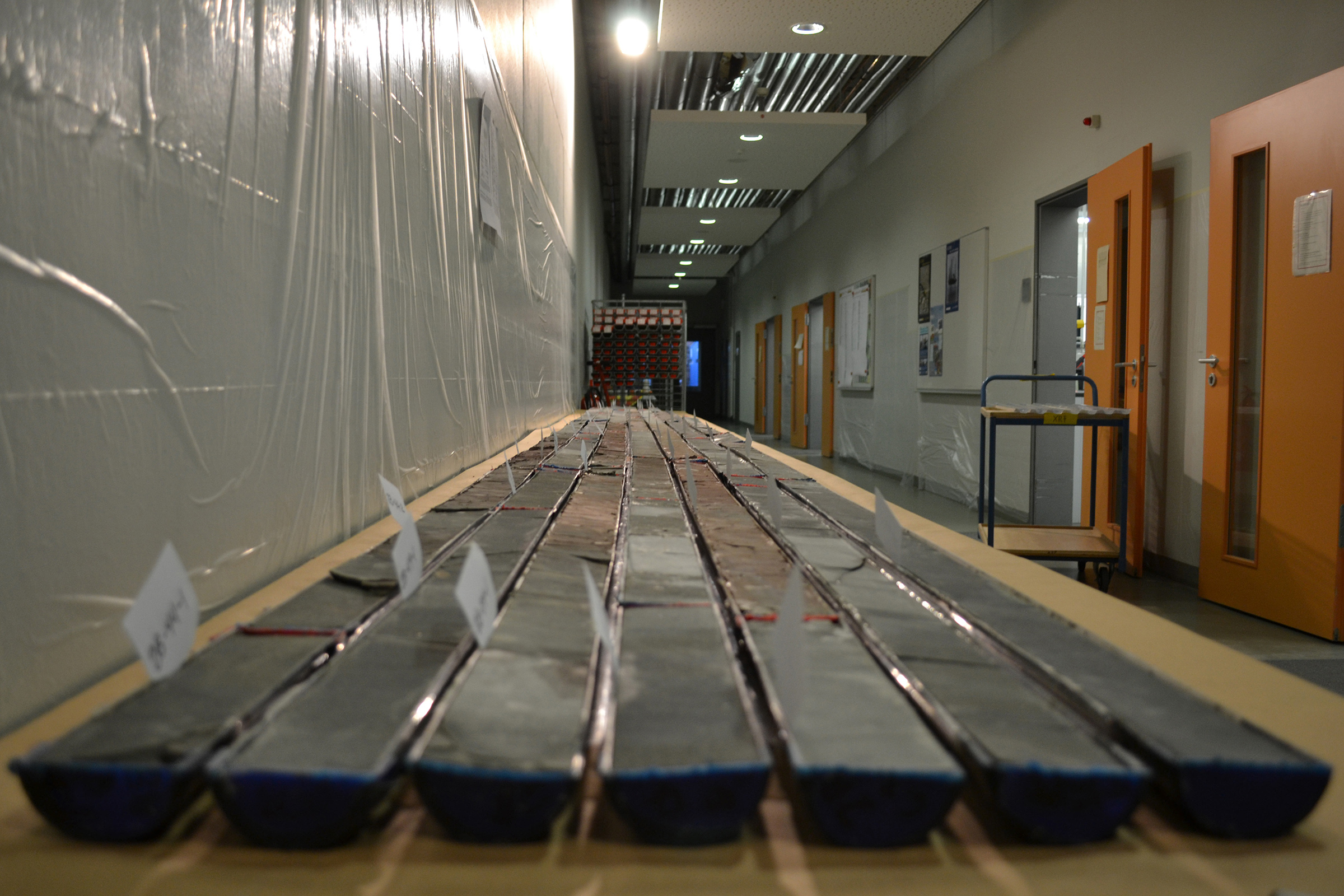 Sediment cores that were drilled from Wyoming's Bighorn Basin and then sectioned for study are shown at a repository at the University of Bremen, Germany. A study of the cores led by University of Utah geochemist Gabe Bowen found that carbon emissions to the atmosphere during a global warming period almost 56 million years ago were more similar to today's human-caused climate change than previously was believed.