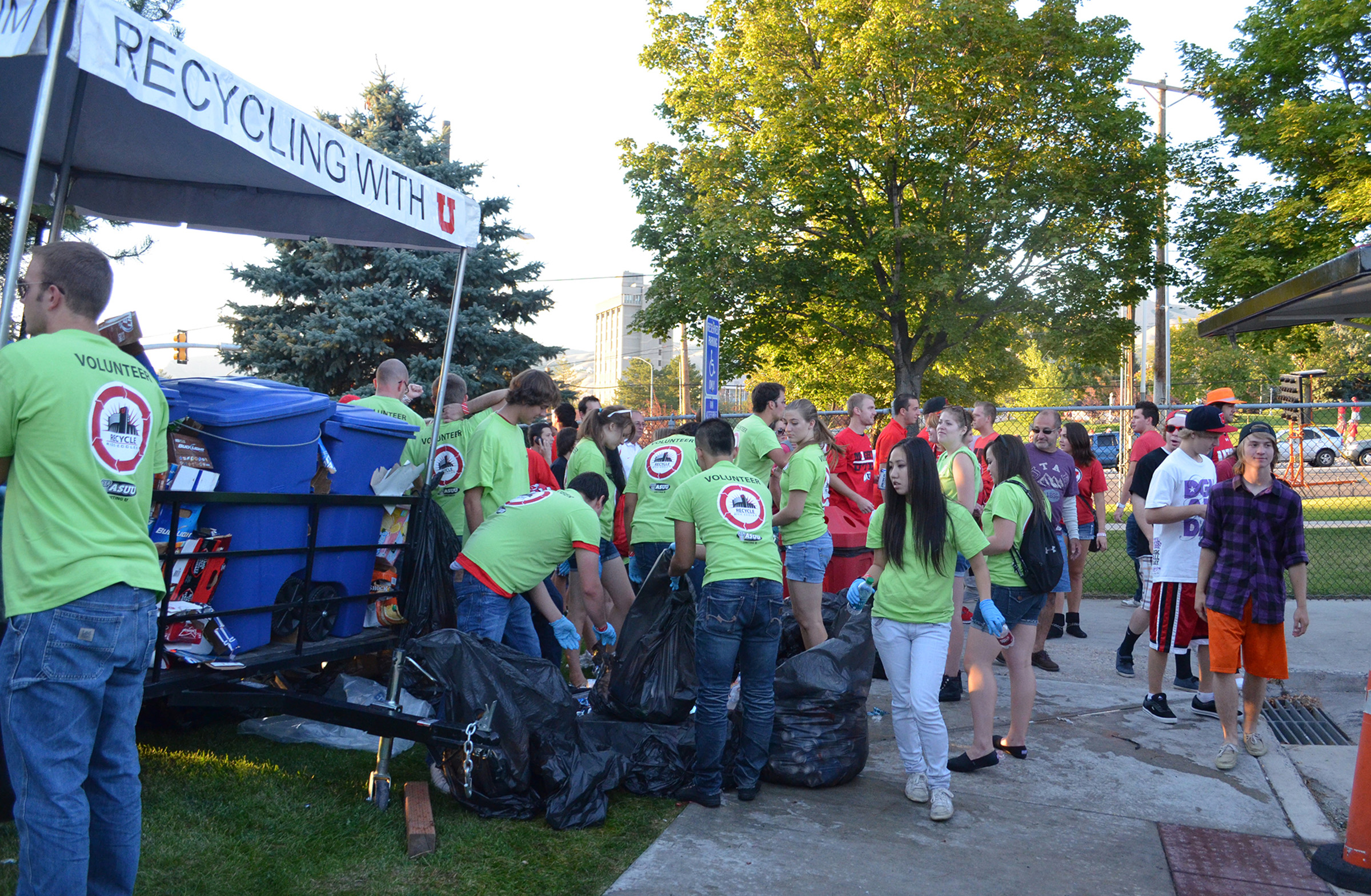 """The student-run Recycle Rice-Eccles initiative aims to prevent recyclable items from entering landfills, collecting roughly 25,000 pounds in cans, bottles and other recyclables annually from football tailgating lots. This is one of many ongoing efforts the U has made to """"green"""" university Athletics."""