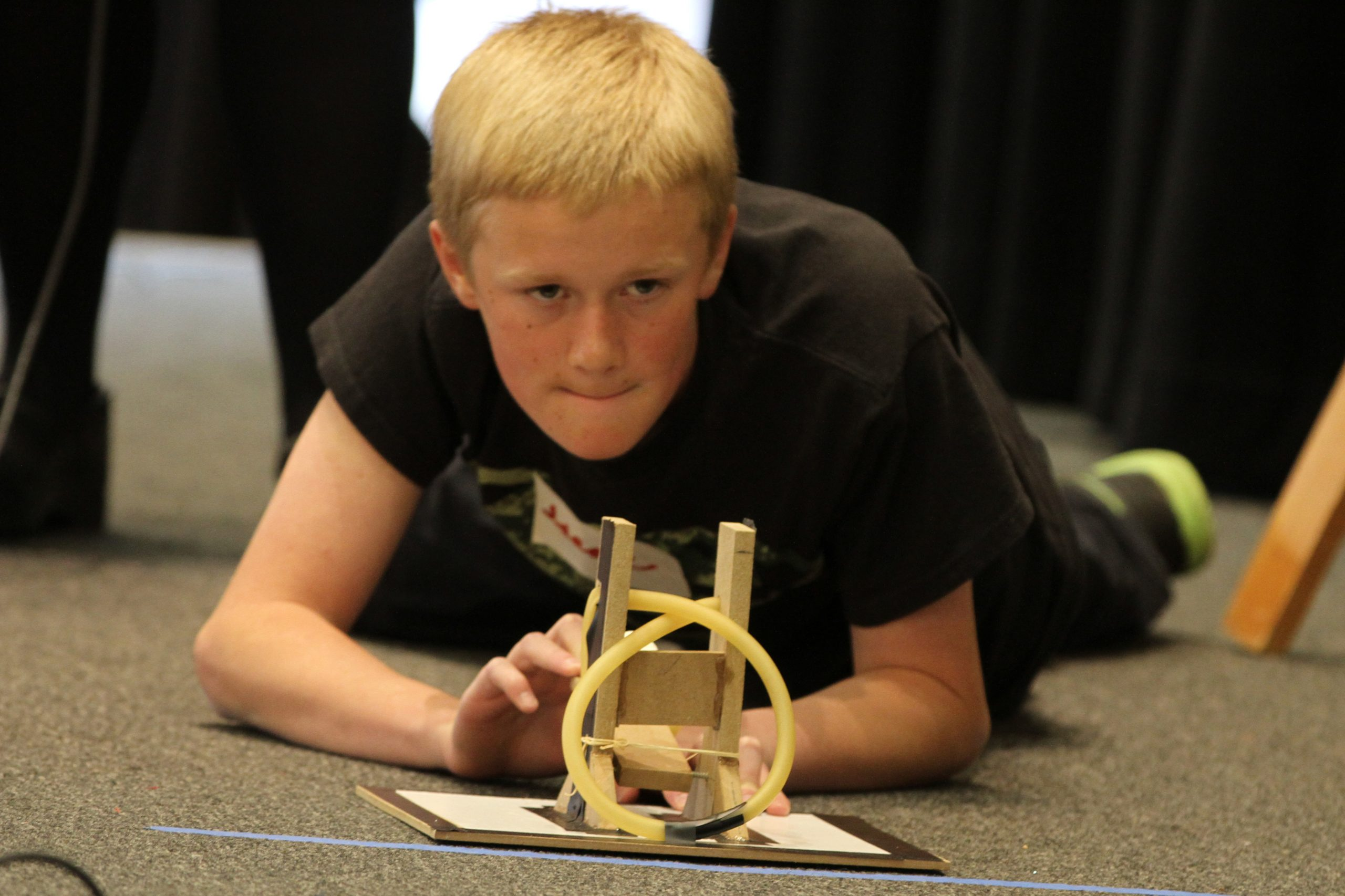 An elementary student launches a marshmallow from a homemade catapult he constructed for Elementary Engineering Week at the University of Utah The event, organized by the U's College of Engineering and sponsored by Phillips 66, takes place March 23–27 at the University of Utah's A. Ray Olpin Student Union Building ballroom, 200 S. Central Campus Drive, Salt Lake City. Each day runs from 9:30 a.m. to noon. Elementary Engineering Week invites nearly 2,000 Utah students to come and learn about engineering concepts. Activities include testing wood catapults they built in class, building fish that swim out of modeling clay, and constructing a skyscraper that can withstand a blast of wind.