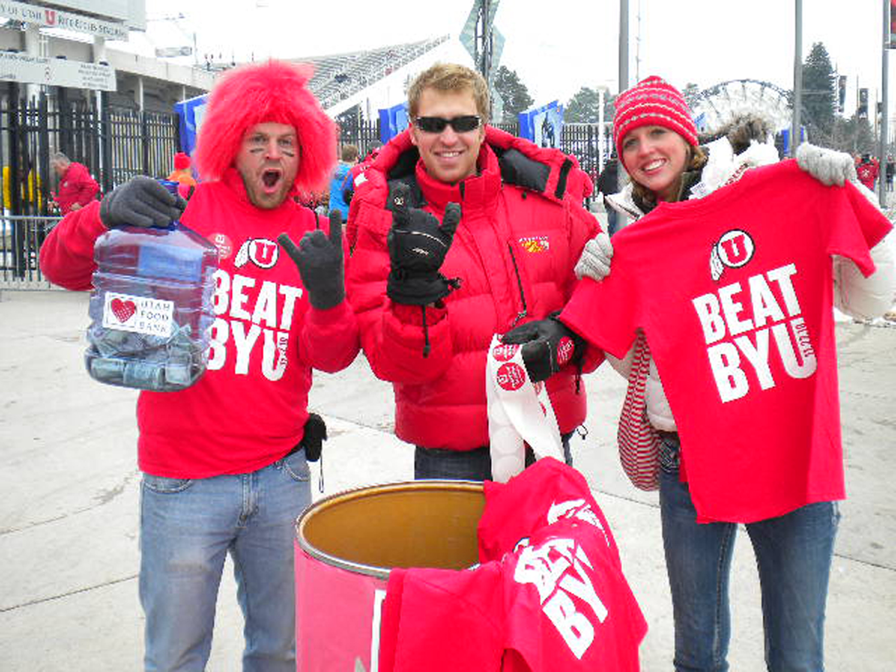 John van Tassell, Cameron King, Suzanne Schmidt King – members of the University of Utah Student Alumni Board – outside Rice-Eccles Stadium during the 2010 Utah vs. BYU food drive. This year's drive runs Nov. 12-25. Cash donations and nonperishable food items will be collected at various locations on the U campus and throughout Salt Lake City to support the Utah Food Bank. Results of the Utah vs. BYU food drive will be released in December.