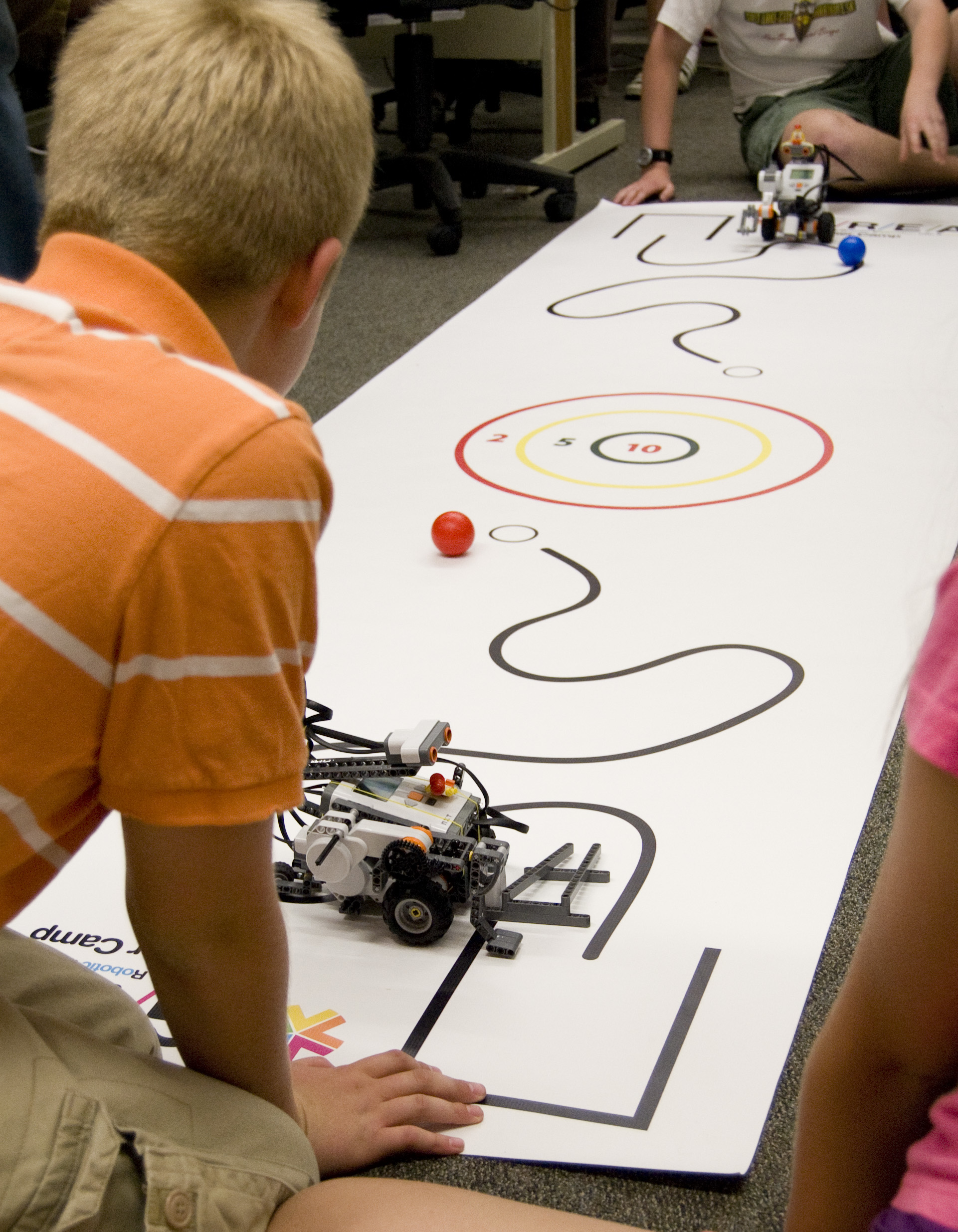 The University of Utah's School of Computing hosts camps every June and July where elementary, middle and high school students learn to program computers, build robots and create animation. Here, a student readies his robot for head-to-head competition in a First Lego League camp.