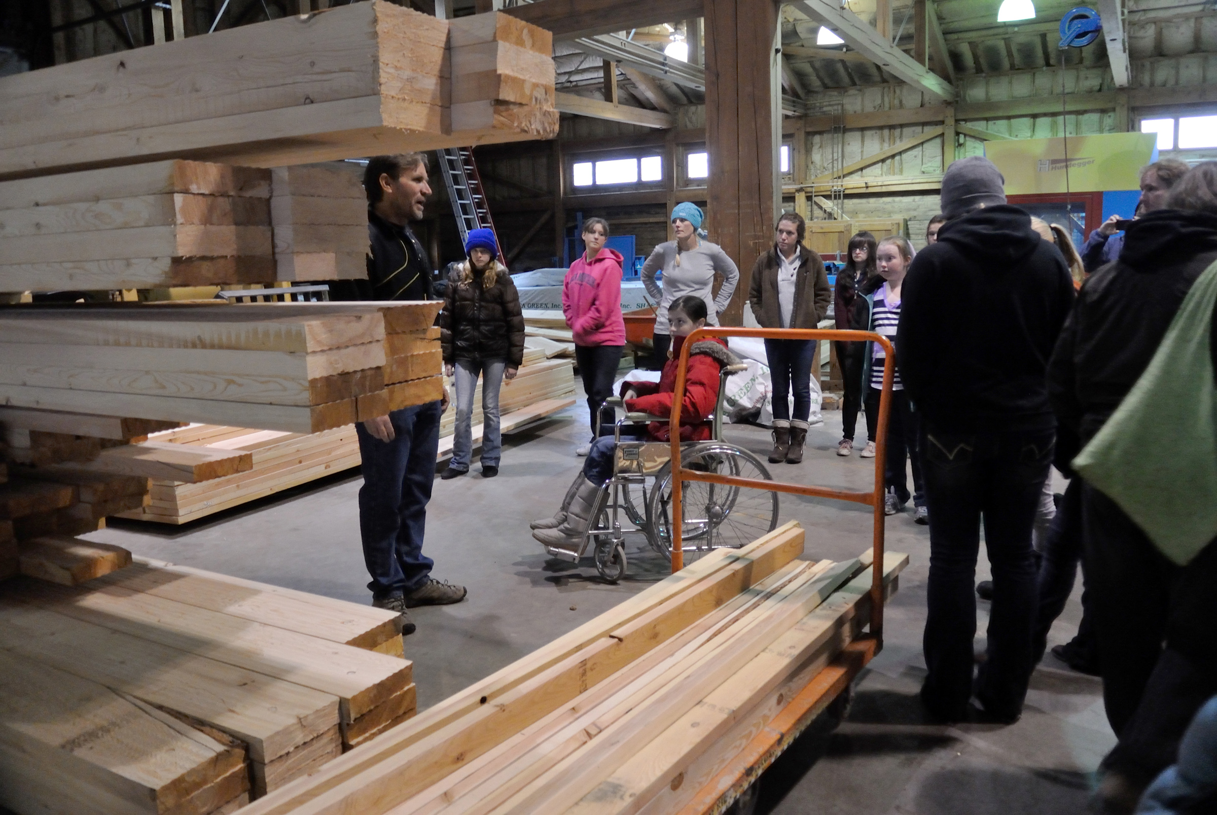 Girl Scouts tour Euclid Timber Frames, a partner on the project and which produces lumber from beetle-kill wood that will be used in the cabins at Trefoil Ranch.