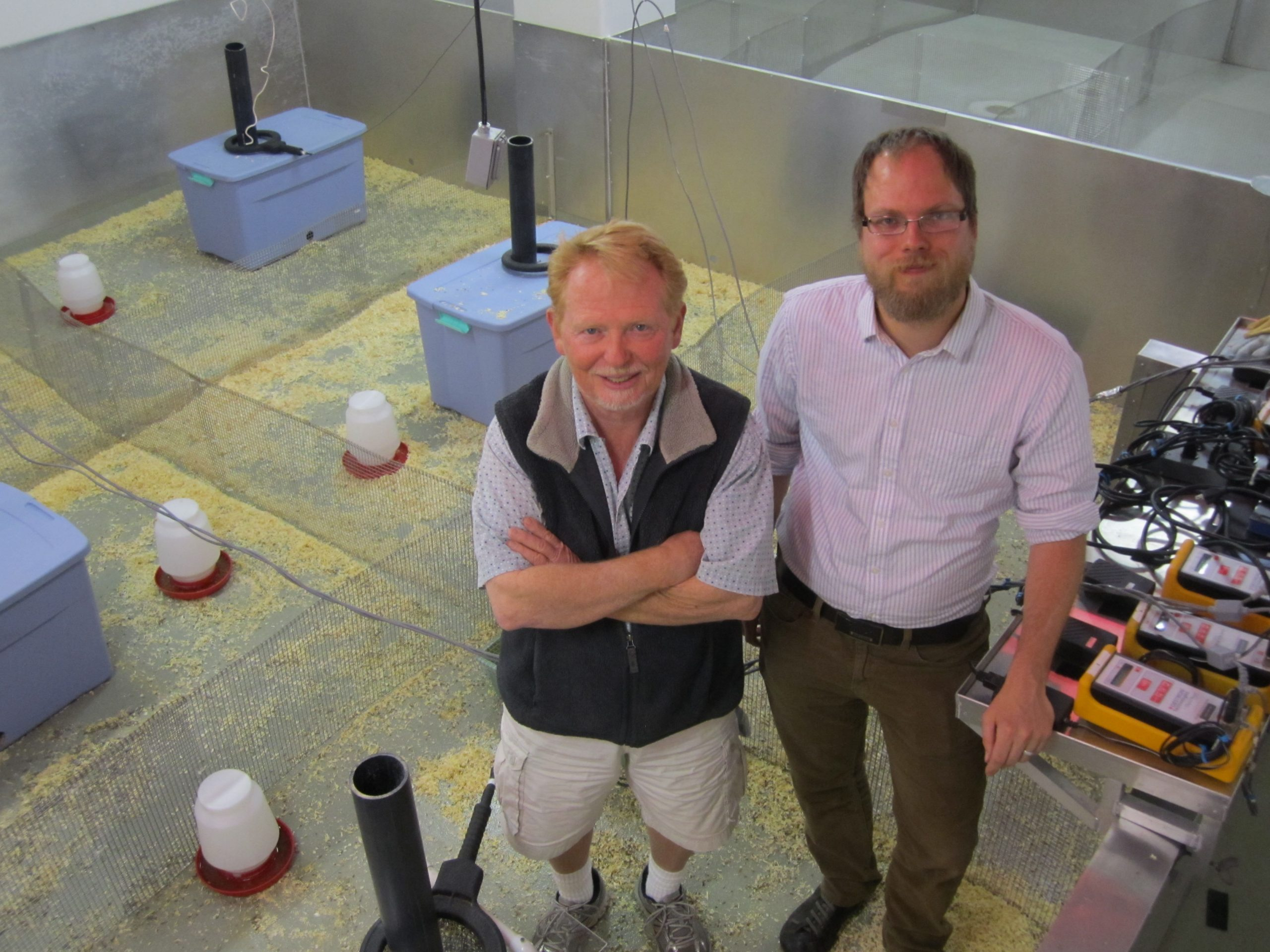 """University of Utah biology professor Wayne Potts, left, and former Ph.D. student James Ruff conducted a new study showing that sugar is toxic to mice in doses proportional to those now considered safe for humans – the equivalent of a health human diet plus three sweetened soda drinks daily. They are standing in one of their """"mouse barns,"""" which were used for a new, sensitive toxicity test in which house mice compete for territory in a more natural environment than small cages."""