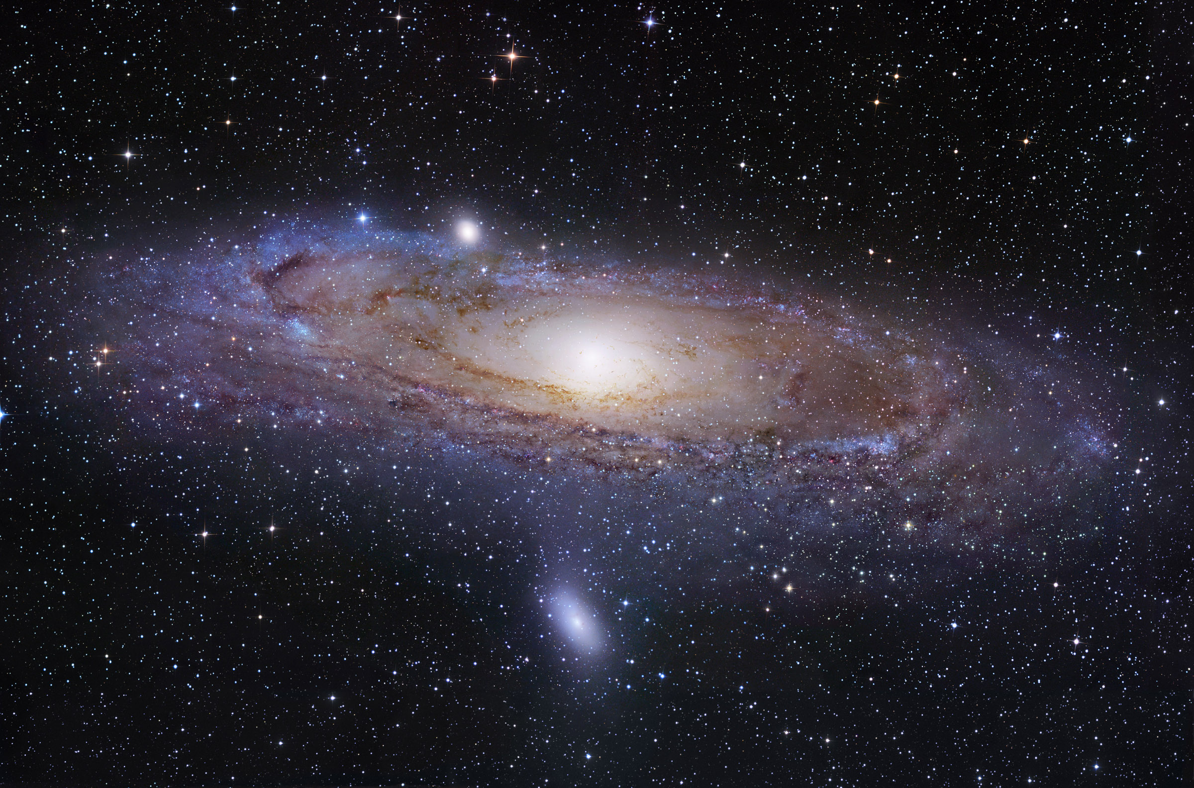 The Andromeda galaxy, shown here, is the closest spiral galaxy to our own spiral, the Milky Way. Astronomers at the University of Utah and elsewhere have launched the Andromeda Project so thousands of volunteers can help them find star clusters in detailed images of Andromeda made by the Hubble Space Telescope.