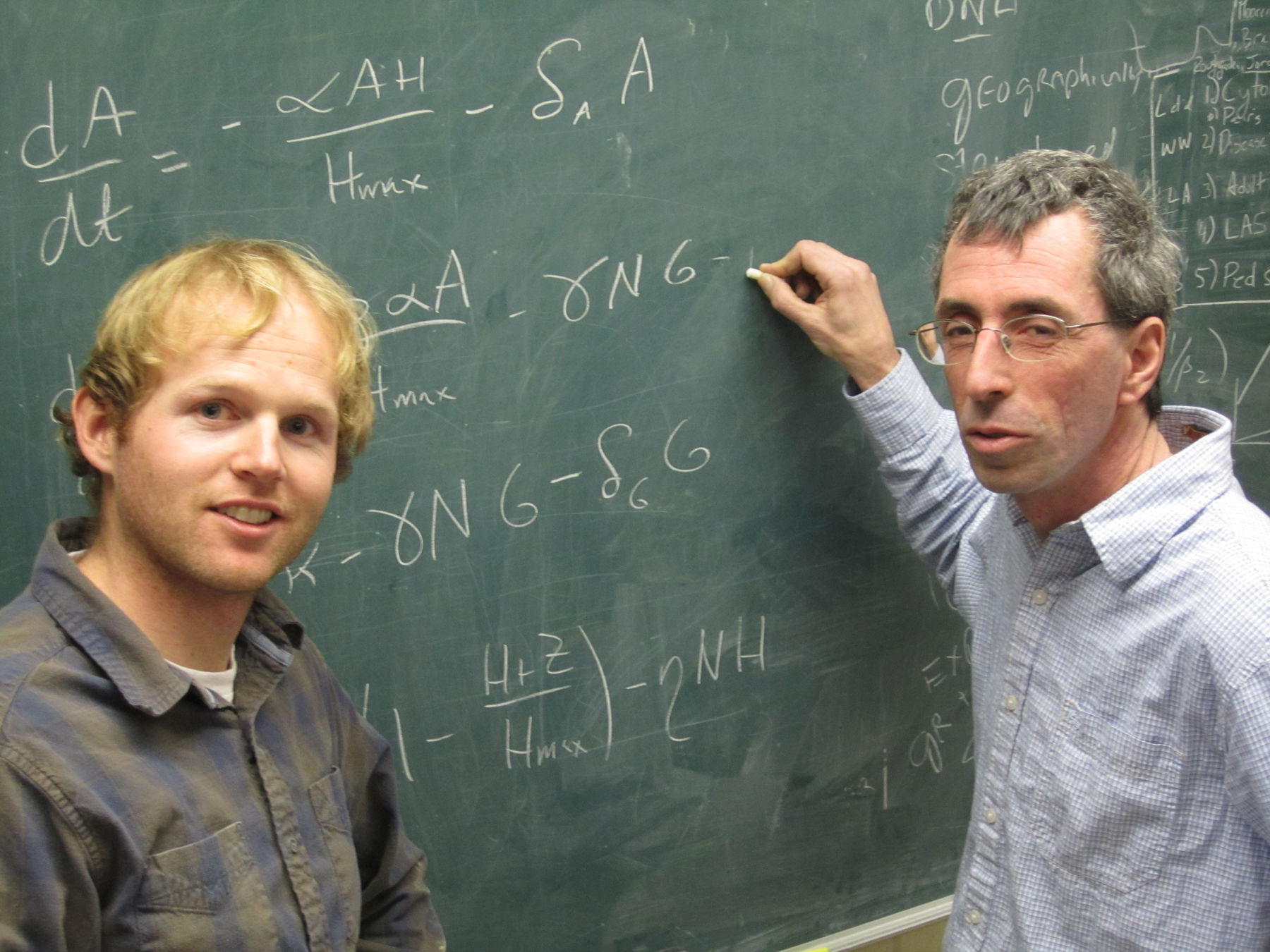 University of Utah mathematicians Chris Remien and Fred Adler with some of the calculus equations that are part of a new method they developed and tested to make it easier for doctors to save Tylenol overdose patients by quickly determining if they can be saved with an antidote or will require a liver transplant to survive.