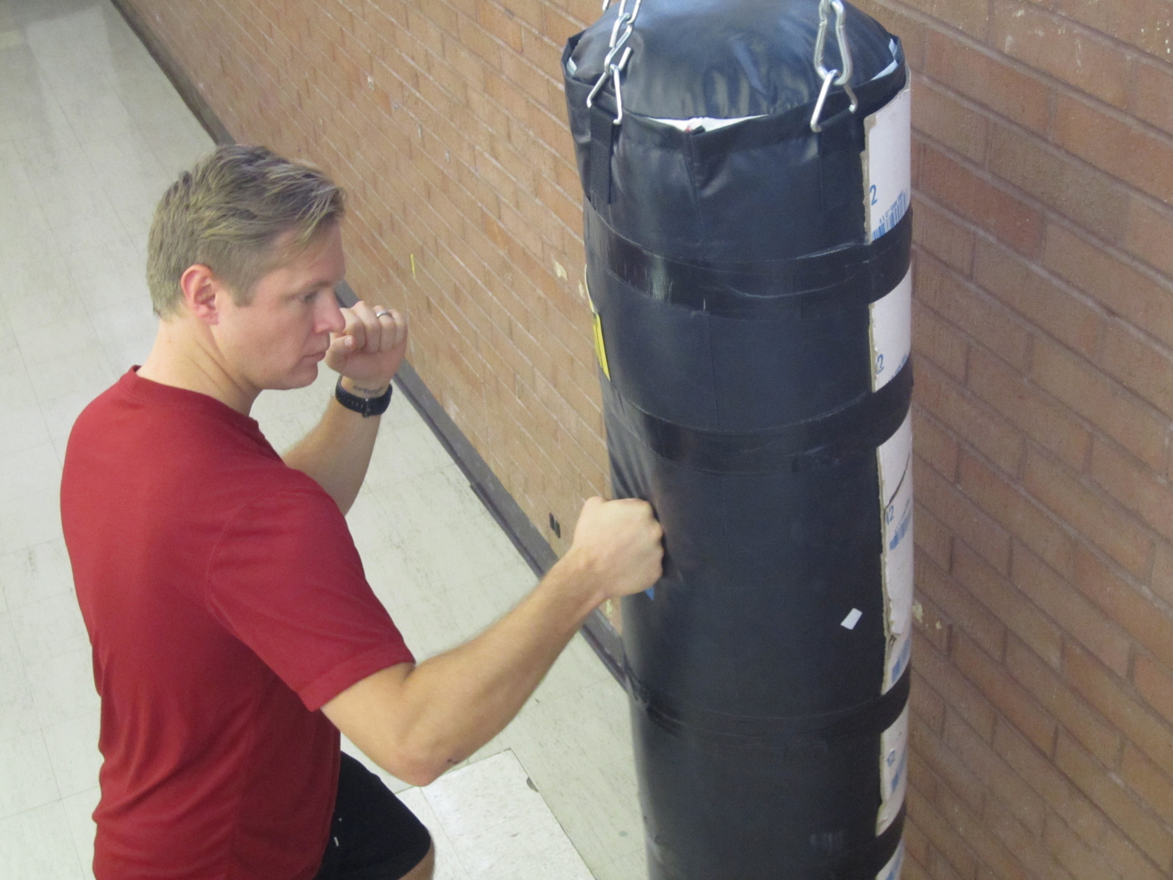 University of Utah medical student Michael H. Morgan strikes a punching bag that was used by Morgan and university biology Professor David Carrier in a study that suggests human hands evolved for fighting with fists, not just for the manual dexterity needed to use tools, play musical instruments and paint artworks.