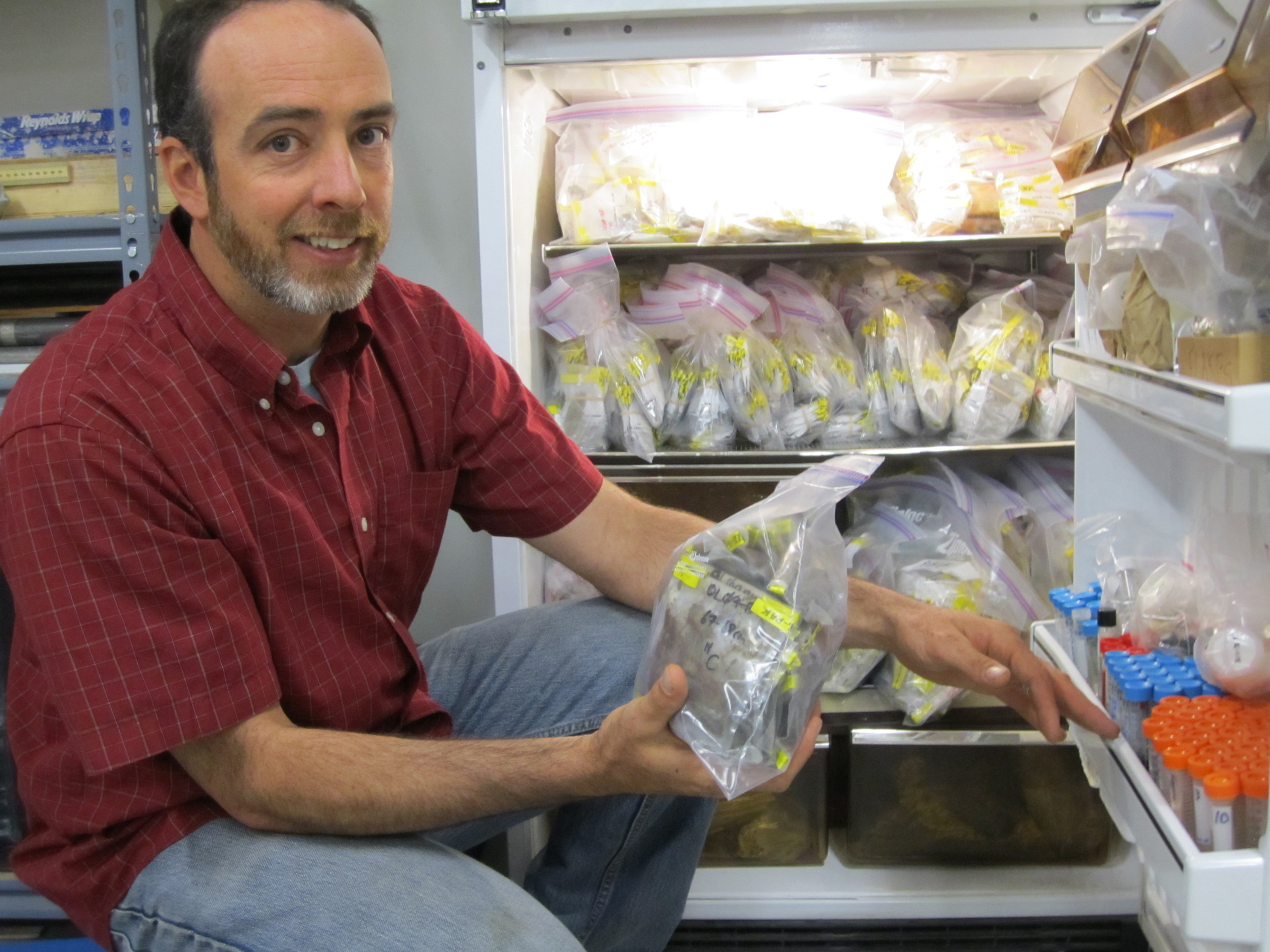 University of Utah researcher Mitchell Power with refrigerated sediment samples in a lab at the Natural History Museum of Utah, where he is a curator. Charcoal in such sediments was the key evidence used in a new study by Powers and colleagues suggesting that the Little Ice Age – a period of global cooling – explains why there were fewer fires after about 1500.