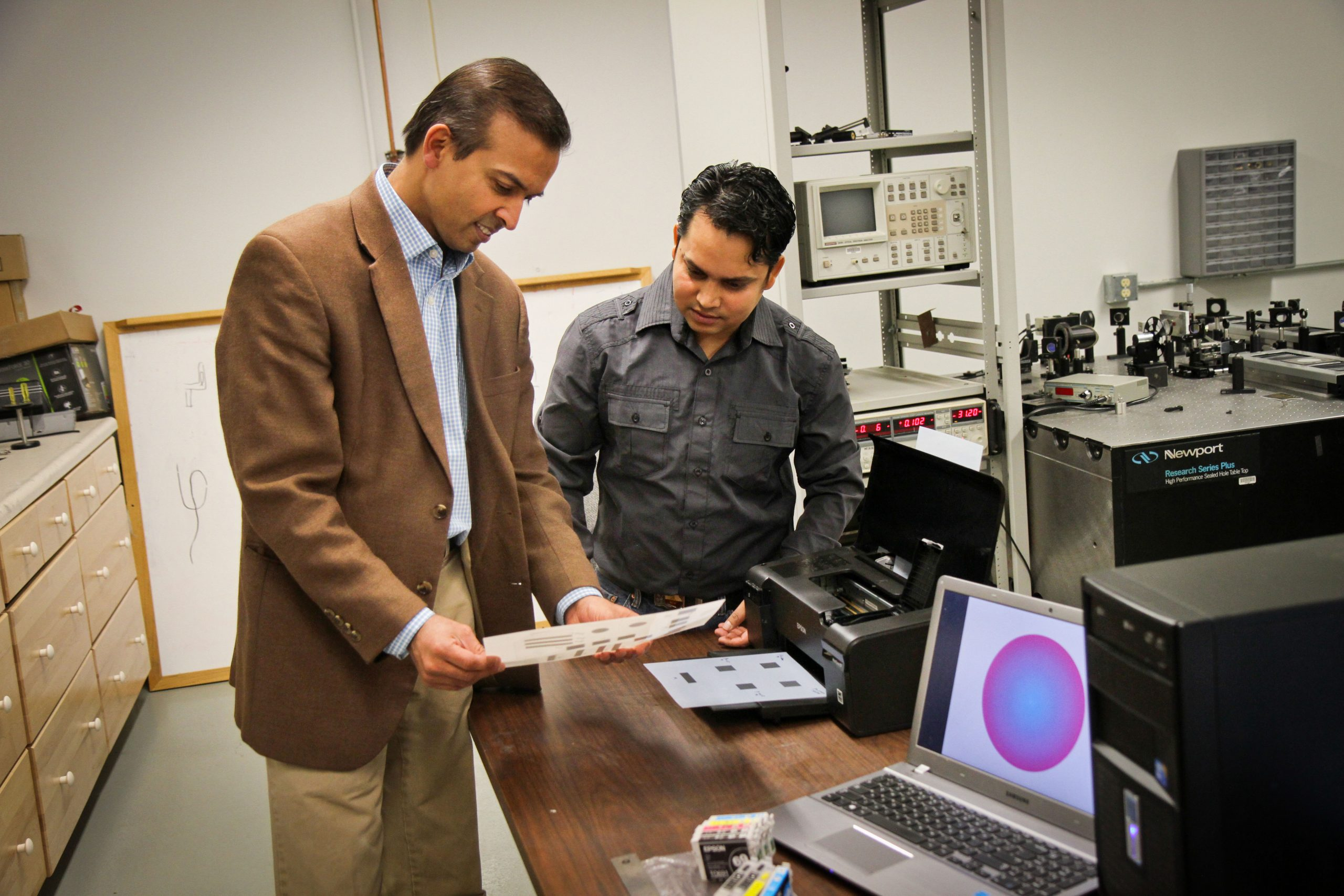 University of Utah electrical engineers Ajay Nahata and Barun Gupta used a $60 inkjet printer with silver and carbon ink cartridges to create a new, widely applicable way to make microscopic structures that use light in metals to carry information. This new technique could be used to rapidly fabricate superfast components in electronic devices, make wireless technology faster or print magnetic materials.