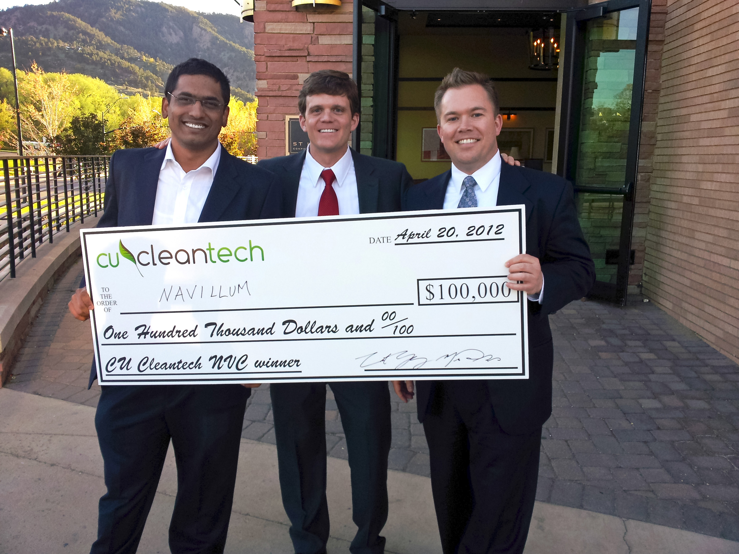 M.B.A. students from the David Eccles School of Business at the University of Utah pose with a $100,000 check they won at the CU Cleantech New Venture Challenge. Picture are, left to right, Ameya Chaudhari, Chris Lewis and Ryan Tucker.