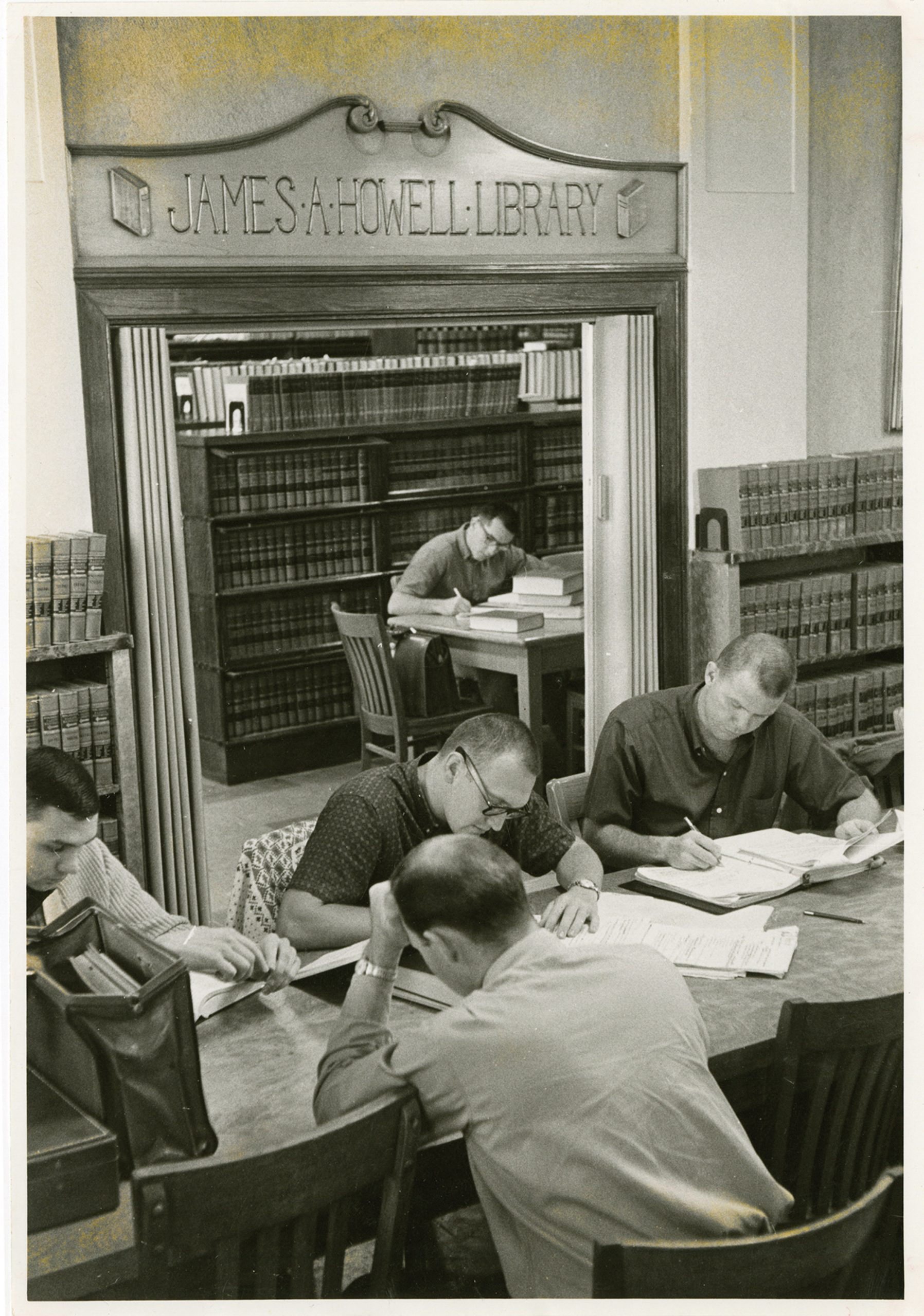 Law students study in the original law library on the top floor of the Park Building. Circa 1950.