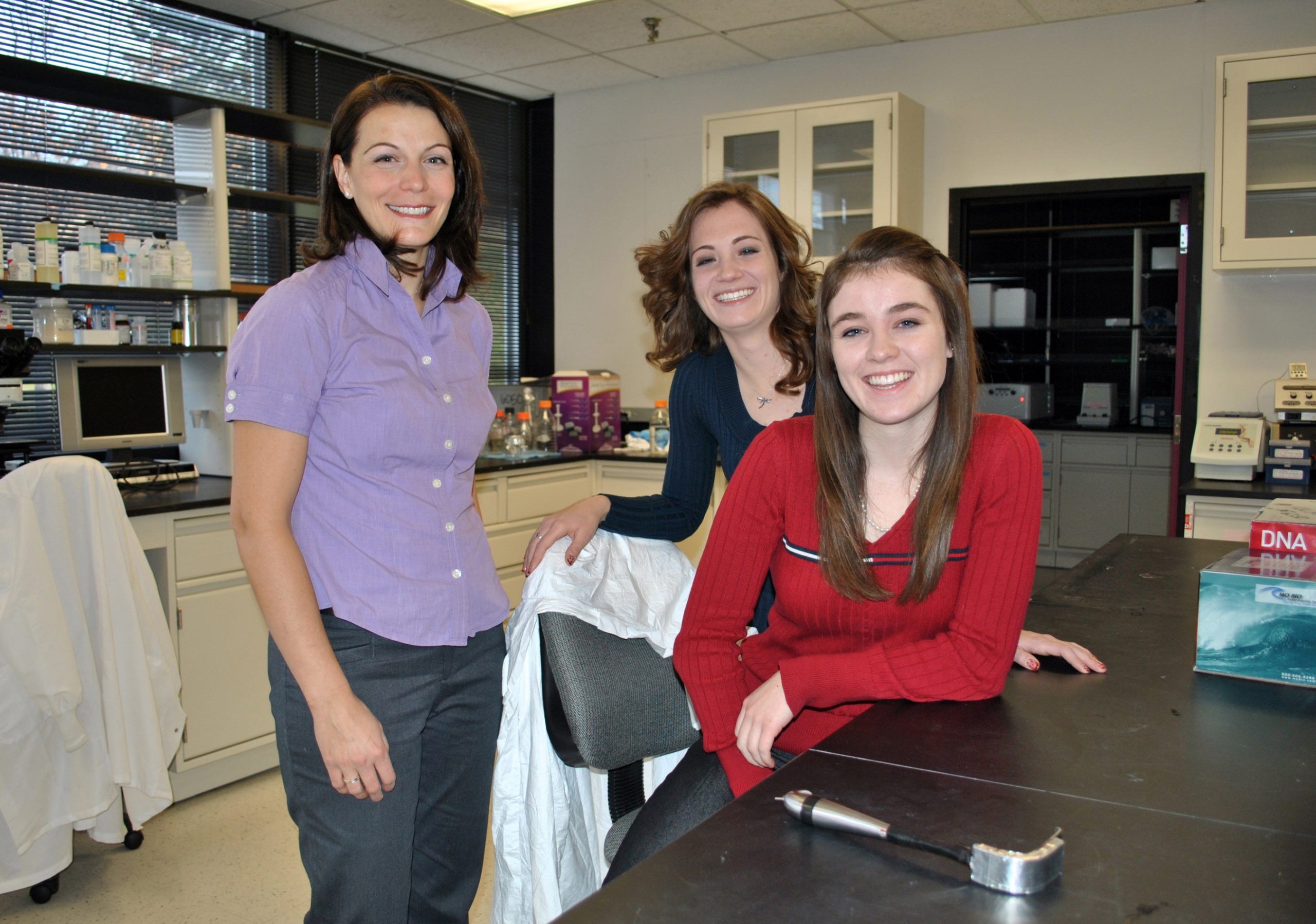 Sophomore bioengineering students Jessica Ashmead (center) and Annicka Carter (right) are behind OptiGuide, a new medical device for lighting incisions during surgery. Also pictured is Dr. Holly Holman, a faculty member in the Department of Bioengineering and the team's mentor.