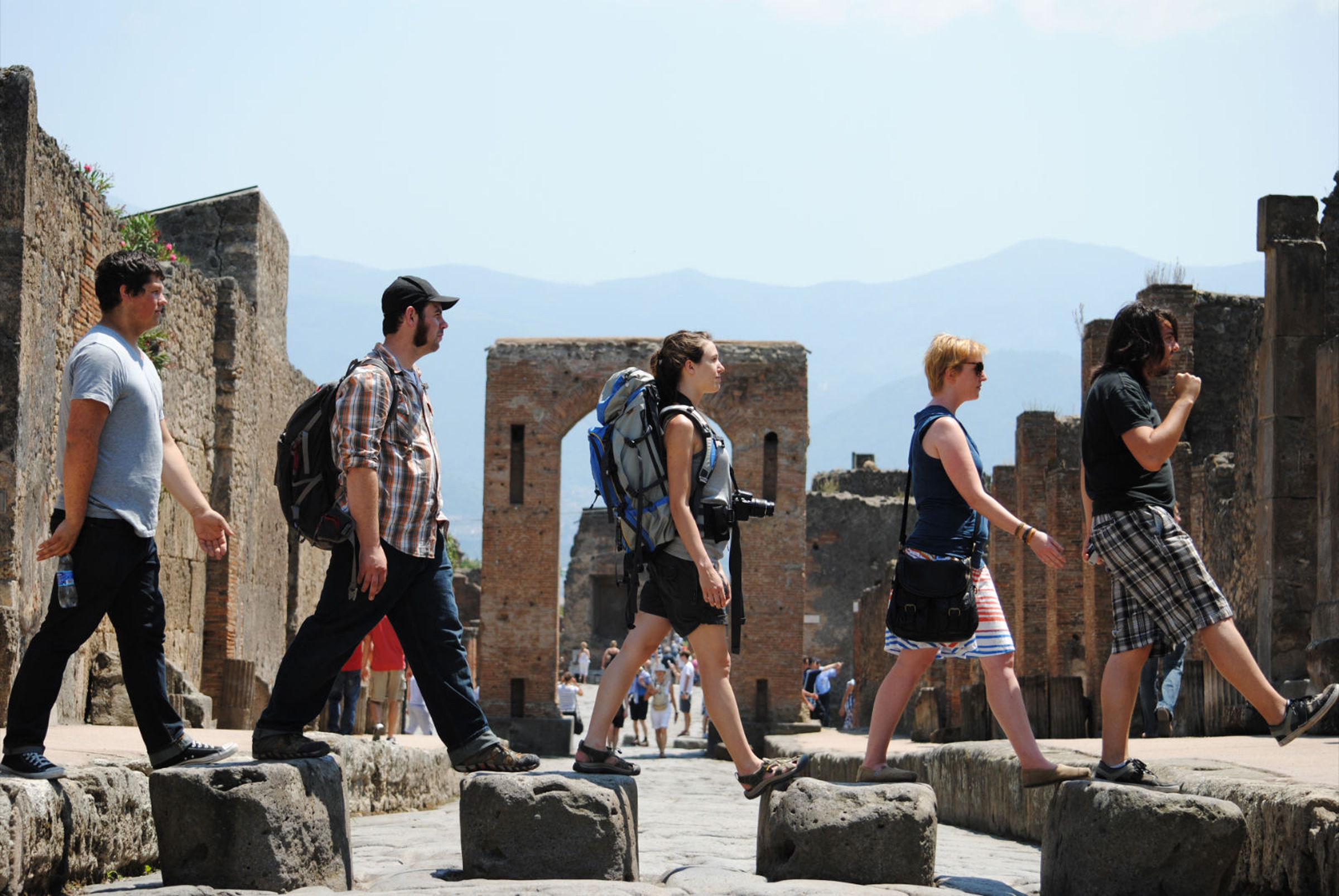 """These students walk through ruins in Siena Italy while participating in the """"From Minoan to Modern Times"""" program."""