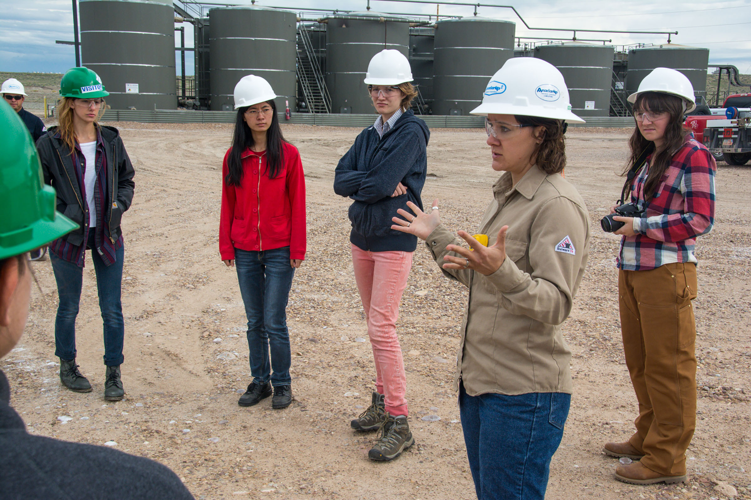 """Students (from left to right: Tyler Cain, Runzhi Dong, Isobel Lingenfelter, Christianna Johnson) from the """"Air Quality, Health and Society"""" Honors Praxis Lab receive a tour of the Anadarko natural gas fields outside of Vernal, Utah during their fall 2014 field trip."""