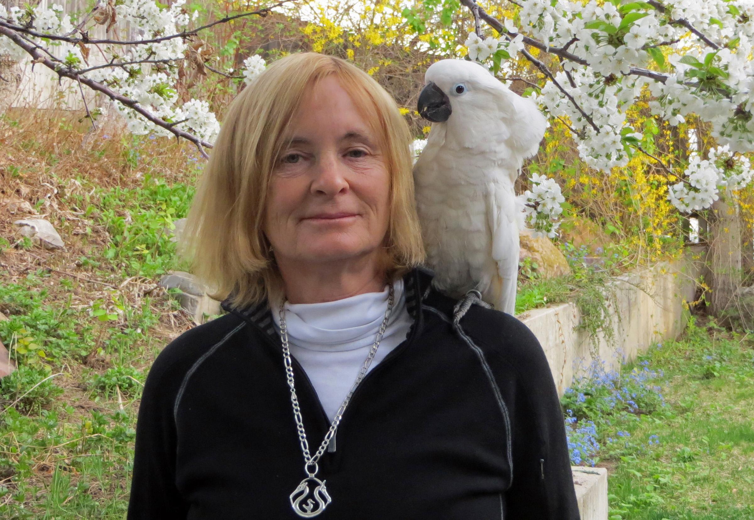 University of Utah anthropology professor Polly Wiessner with Bird, her pet cockatoo.