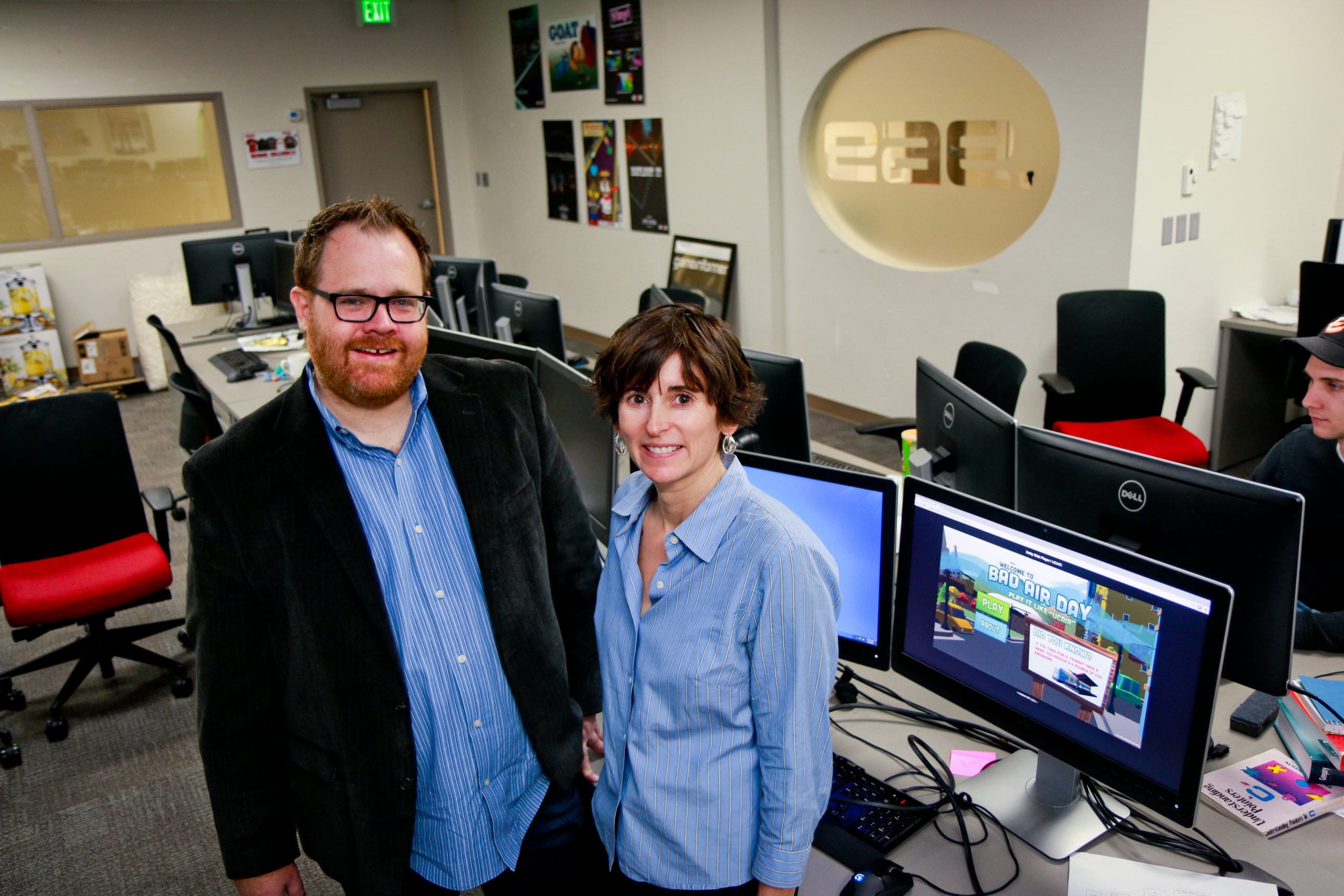 """Roger Altizer, EAE Director of Therapeutic Games and Apps (The Gapp) Lab at the University of Utah, left, and Kerry Kelly, a U chemical engineering research associate, have produced """"Bad Air Day: Play It Like 'UCAIR,'"""" a new video game that teaches high school students about what impacts air quality. Kelly, an expert in air quality, came up with the idea for the game and turned to Altizer and the U's Entertainment Arts and Engineering video game design program to produce it."""