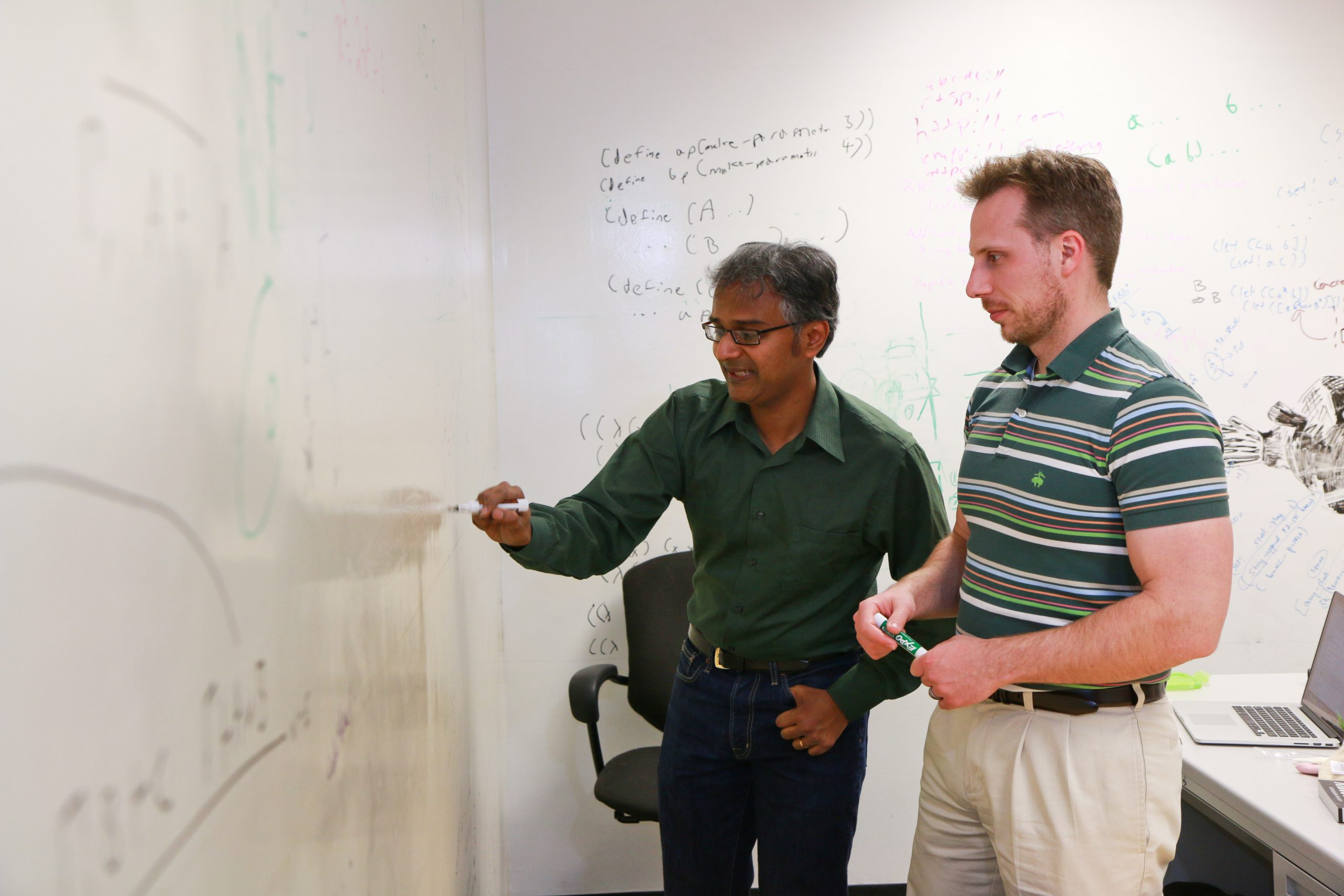 Suresh Venkatasubramanian, left, and Matt Might, both associate professors of computer science at the University of Utah, have received a $3 million government grant to produce software that can sniff out the next generation of computer vulnerabilities. These attacks, called algorithmic vulnerabilities, are harder to detect and can do a great amount of damage on computer systems.
