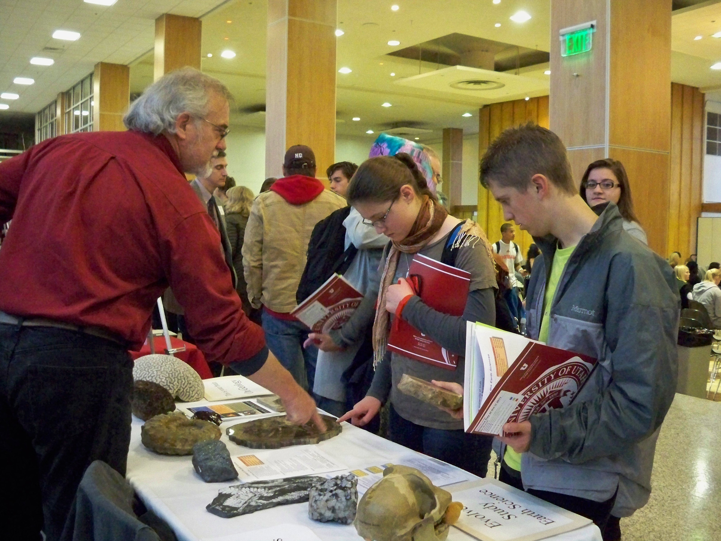 High school students examine an Earth science exhibit during the University of Utah's 2001 Science Day at the U. This year's Science Day at the U is set for Saturday, Nov. 10. It is the university's largest recruitment event, attracting some 800 high school students. To attend, students must register online by noon Nov. 6 at www.science.utah.edu.