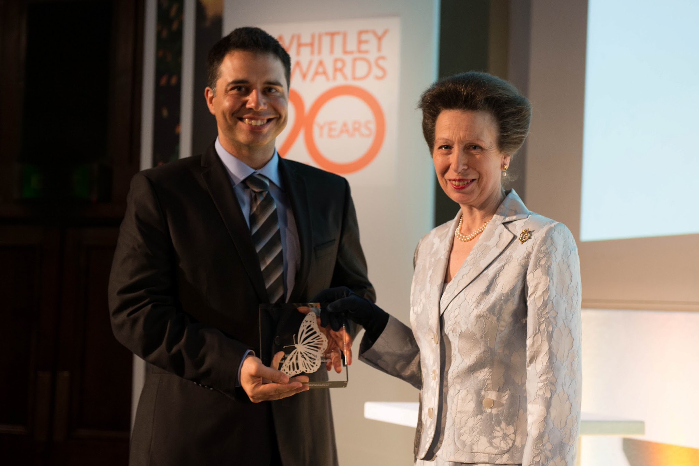 University of Utah biologist Çağan Şekercioğlu accepts the prestigious 20th Anniversary Whitley Gold Award for nature conservation from the United Kingdom's Princess Anne on Thursday, May 2, 2013 during a ceremony at the Royal Geographical Society in London.