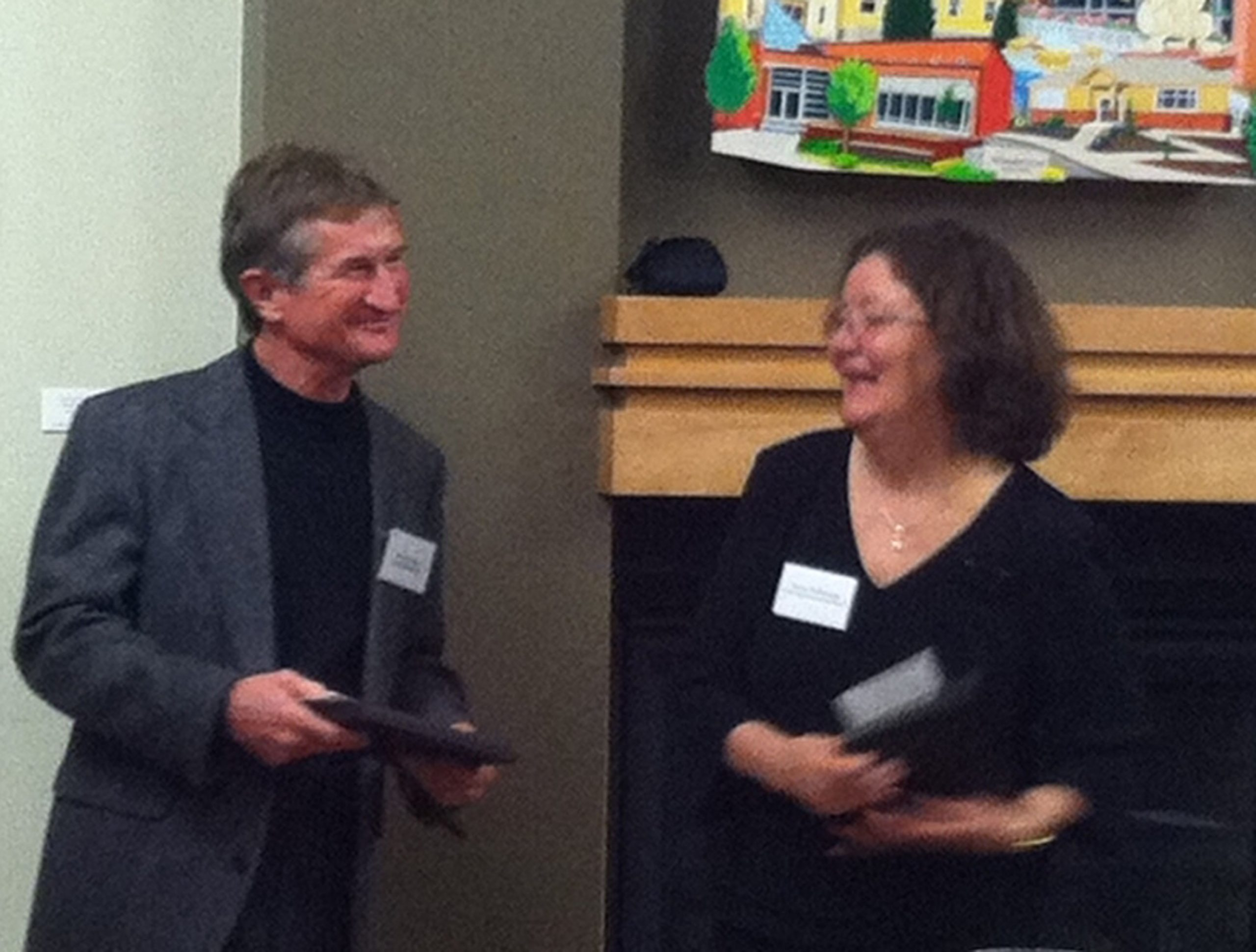 Steven Simms accepting the award from Ronni McDonough, co-chair of the Utah Book Award.