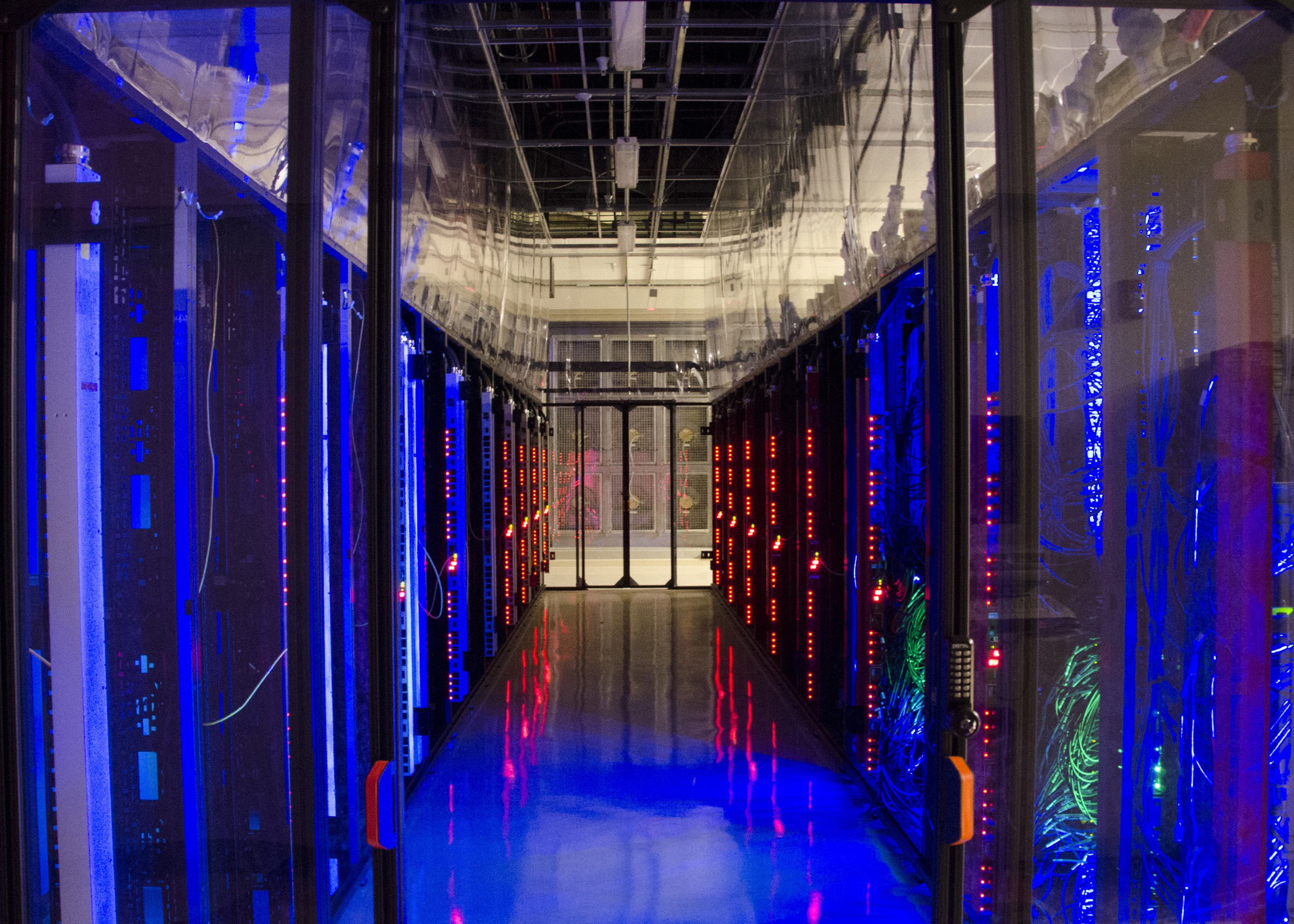 """Power lights on computer networks glow in this photo taken inside the University of Utah's data center in downtown Salt Lake City. With a $10 million grant from the National Science Foundation, the data center will host a new computing facility that will be used to develop """"clouds"""" for real-time disaster response or the security of private data such as medical records. Clouds are computer networks used to run software applications and store large amounts of data online. The new facility will be called CloudLab."""