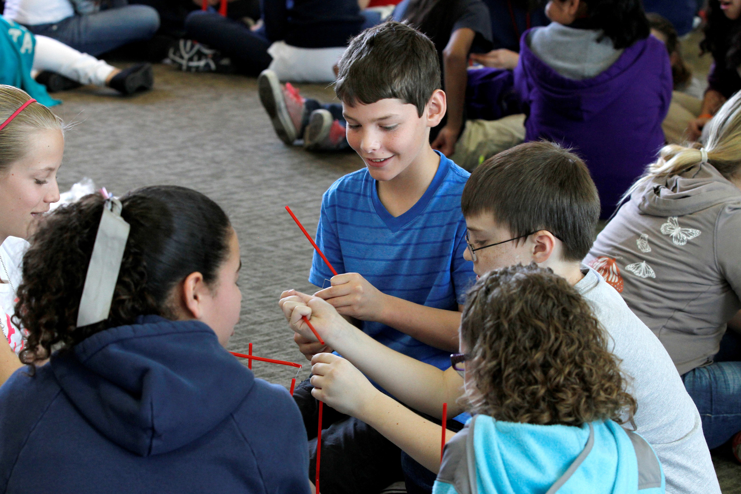 Students use plastic drinking straws to build towers that must withstand wind gusts during last year's Elementary Engineering Week. This year's event during March 24-28 will draw 2,000 Wasatch Front fifth- and sixth-graders. The week of activities is hosted by the University of Utah College of Engineering.