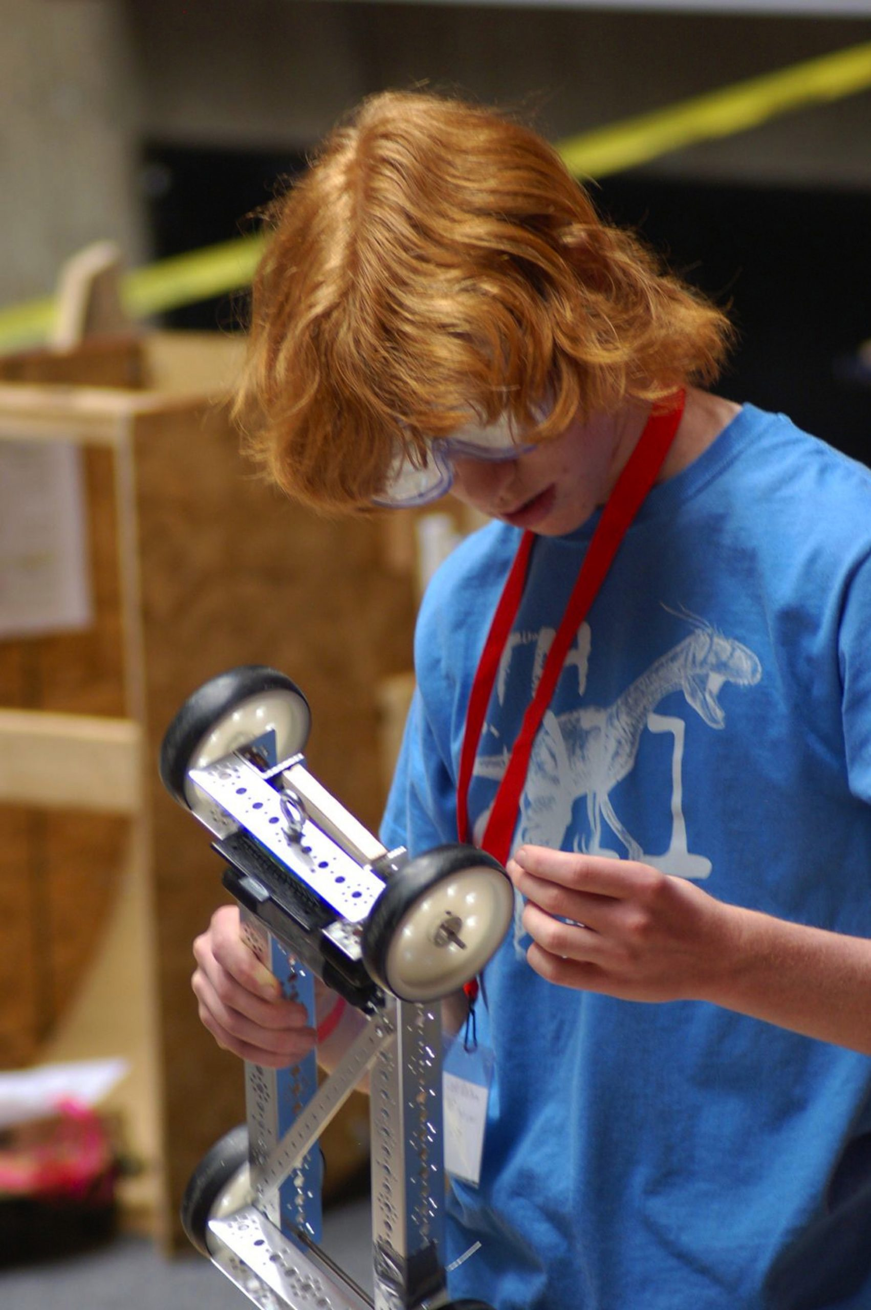 A student competing in the 2012 Utah Science Olympiad adjusts a wheel on his vehicle. More than 900 students will descend on the University of Utah campus for the 2013 Utah Science Olympiad on Saturday, April 13.