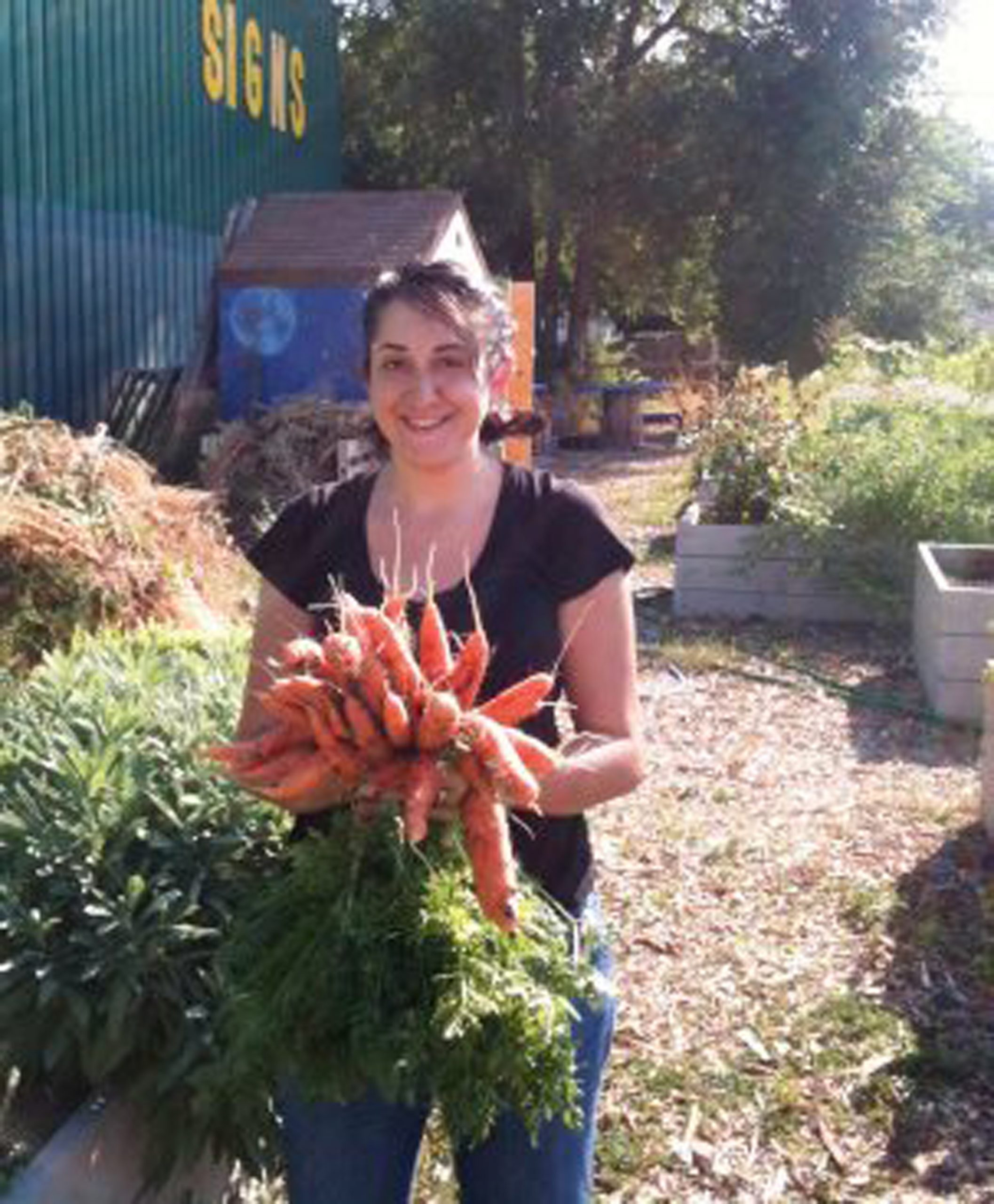Miriam with her carrot harvest at the People's Portable Garden.