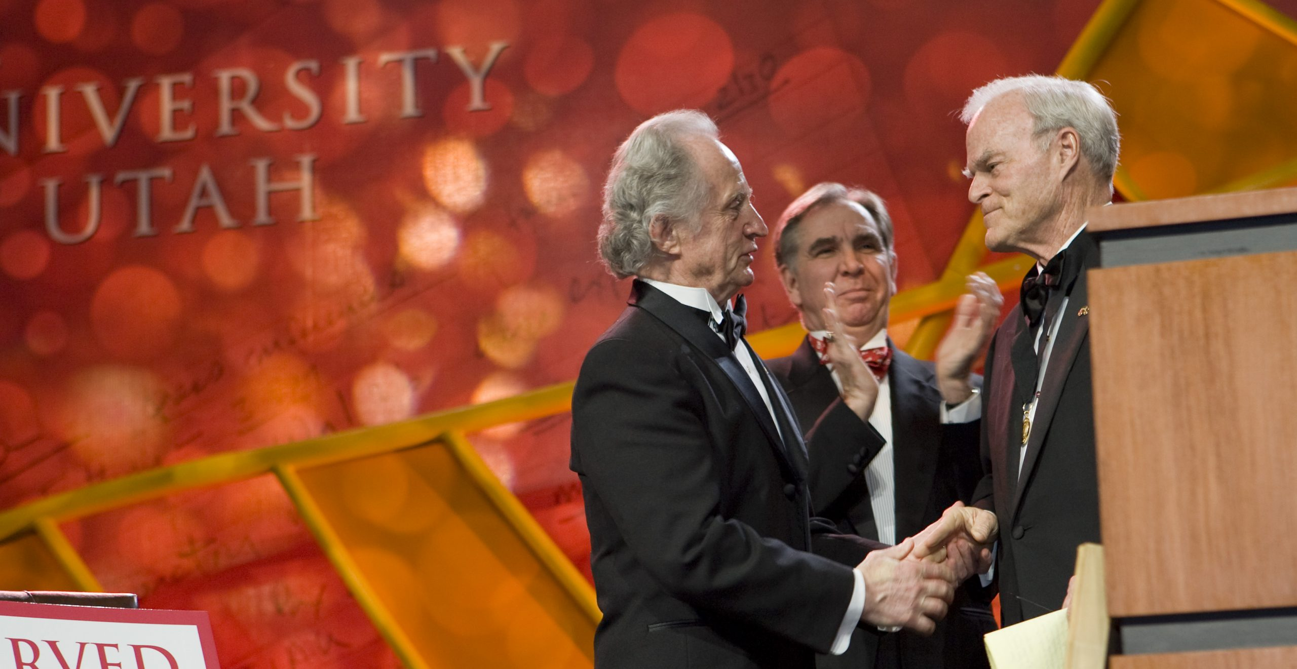 From left to right: Mario R. Capecchi, U of U President Michael K. Young, and Spencer F. Eccles.