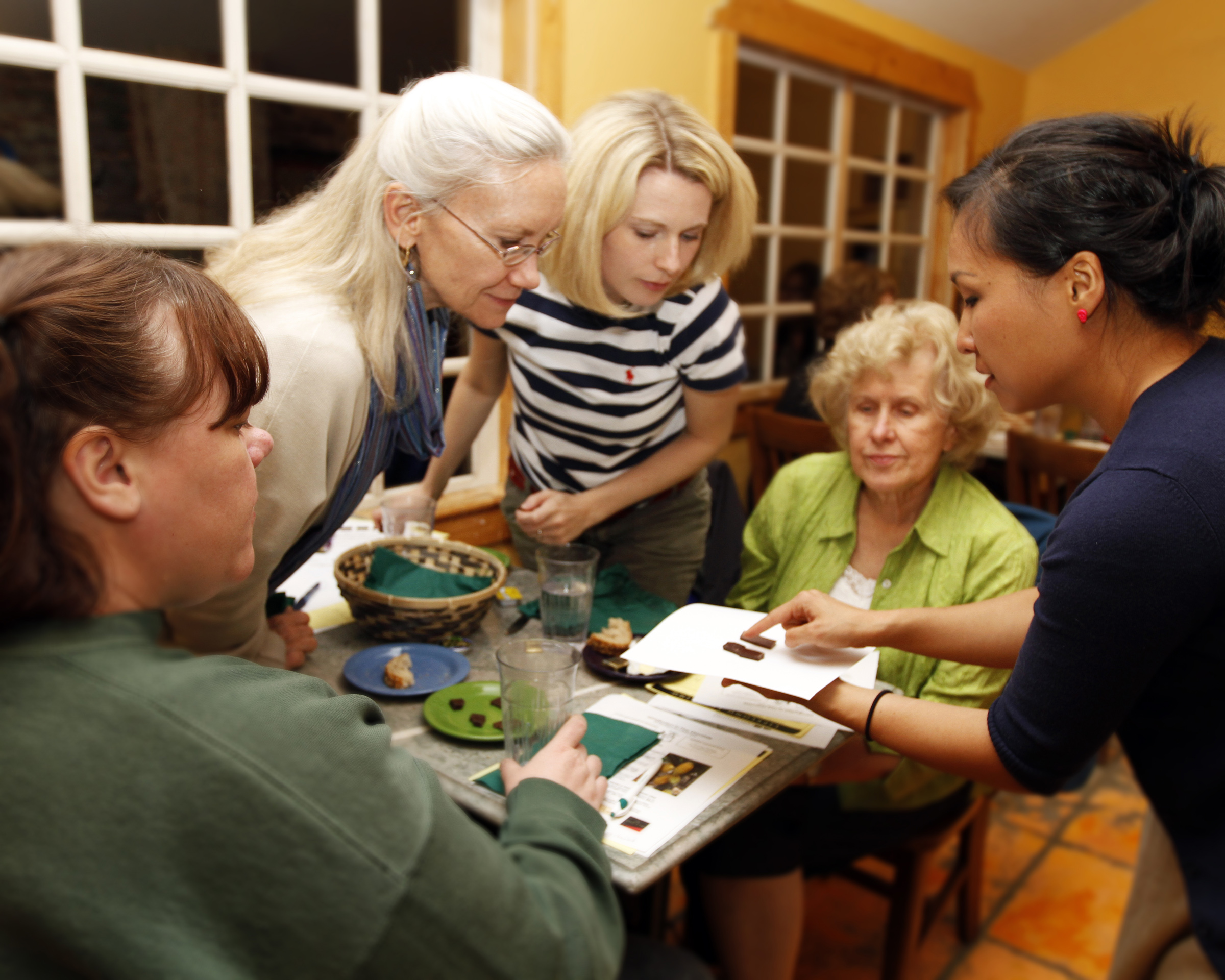 Instructor Vanessa Chang (right) discusses some of Utah's finest chocolates.
