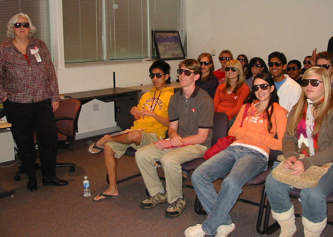Utah and Idaho high school students wear 3-D glasses, as does staff chemist Anita Orendt, left, during a Science Day at the U demonstration of the visualization capabilities of the University of Utah's Center for High Performance Computing.