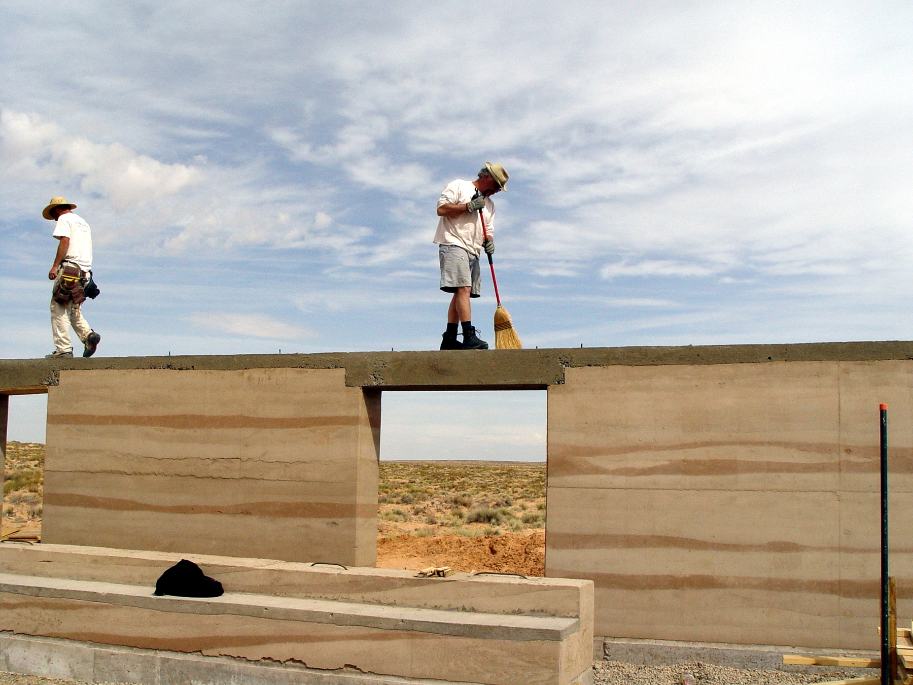 Hank Louis and architecture graduate student work on rammed earth home in Bluff, Utah.