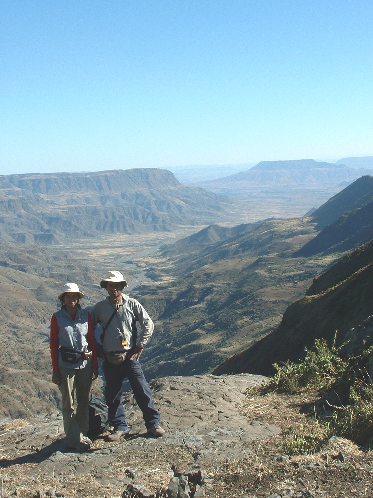 Nahid and Royhan Gani, geologists at the University of Utah's Energy and Geoscience Institute, stand on the Ethiopian Plateau near the Gorge of the Nile, which was carved by Africa's Blue Nile River. The Ganis are studied the timing of the canyon's incision to learn more about how movements of Earth's crust are related to human evolution.