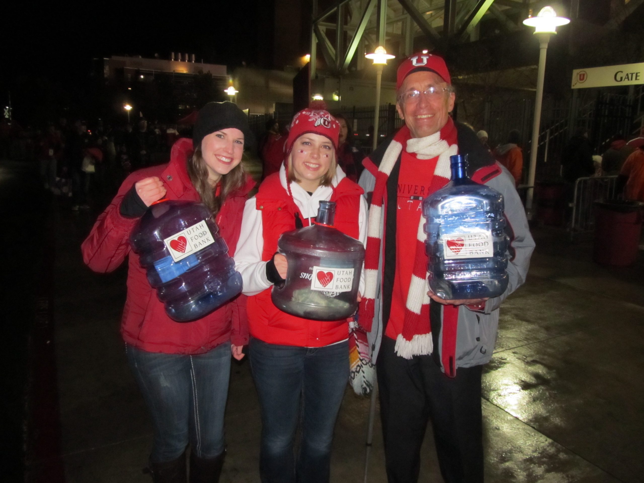 Shelbie Whitchurch, Rachel Kennedy and Steve Gunn collecting donations for food drive.