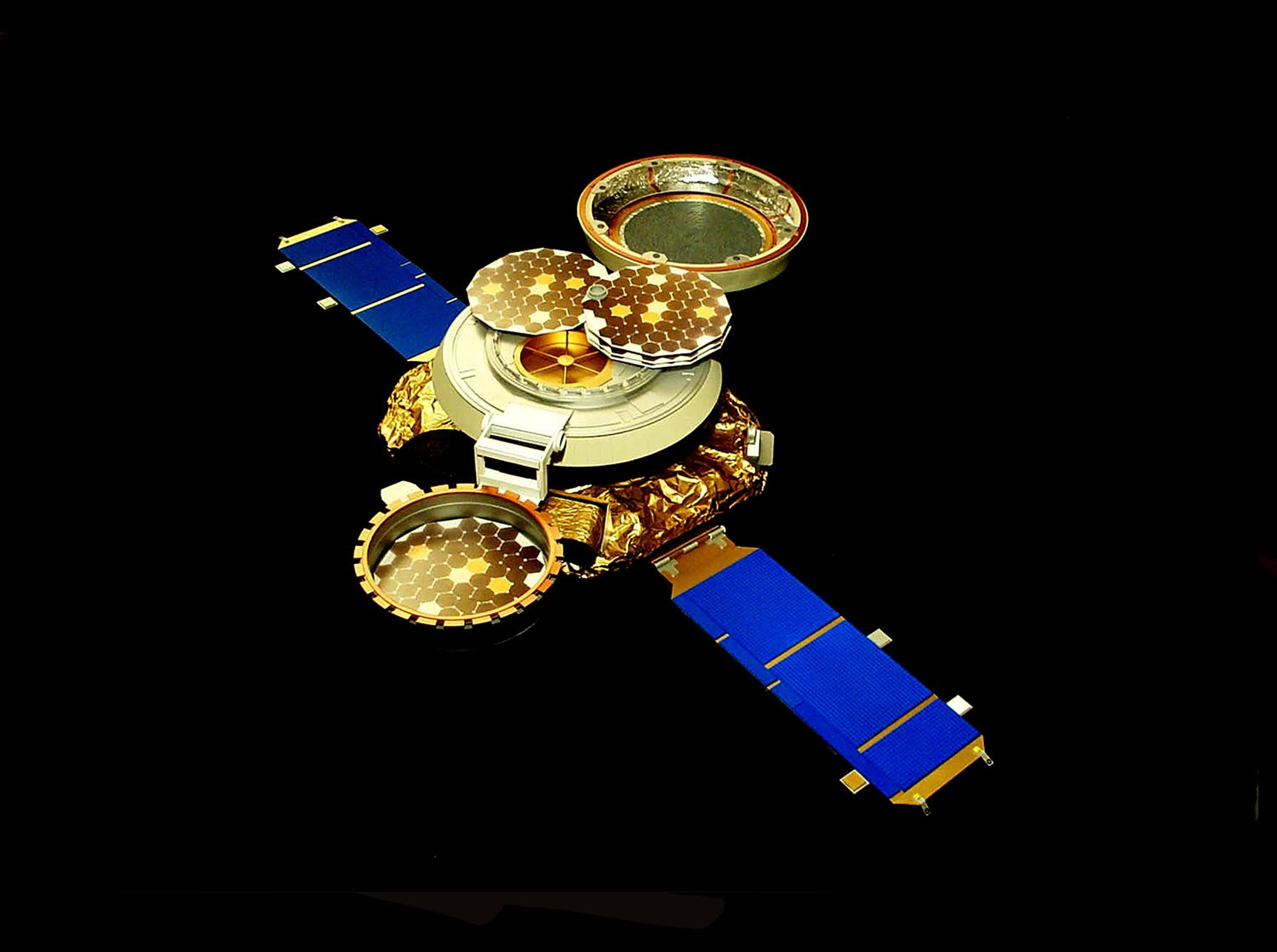Artist's rendering of the Genesis spacecraft as it appeared in space with wafers of gold and other materials deployed to catch solar wind particles.