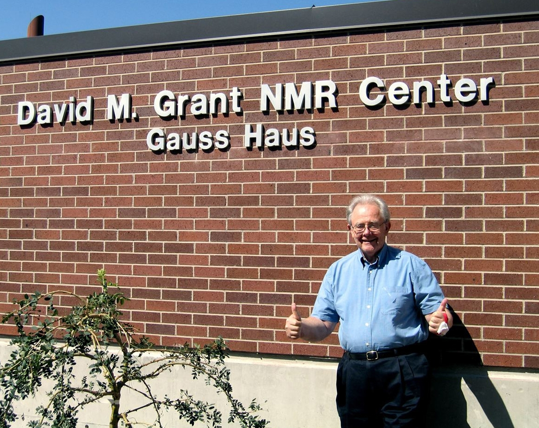 University of Utah chemist David Grant -- a pioneer in the use of powerful magnetic devices and a method known as nuclear magnetic resonance (NMR) spectrometry -- stands in front of the new $14 million NMR center named for him and nicknamed for Carl Friedrich Gauss (1777-1855), a mathematician whose name s used for the units that indicate magnetic field strengths.