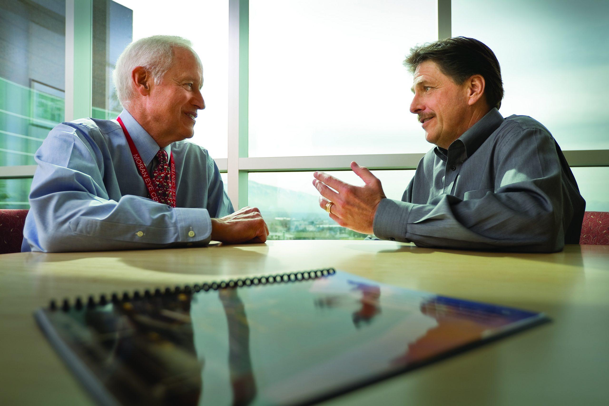 Randall J Olson, M.D., CEO of the John A. Moran Eye Center (left), And Gregory S. Hageman, Ph.D., Director of the Moran Center for Translational Medicine at the John A. Moran Eye Center (right).