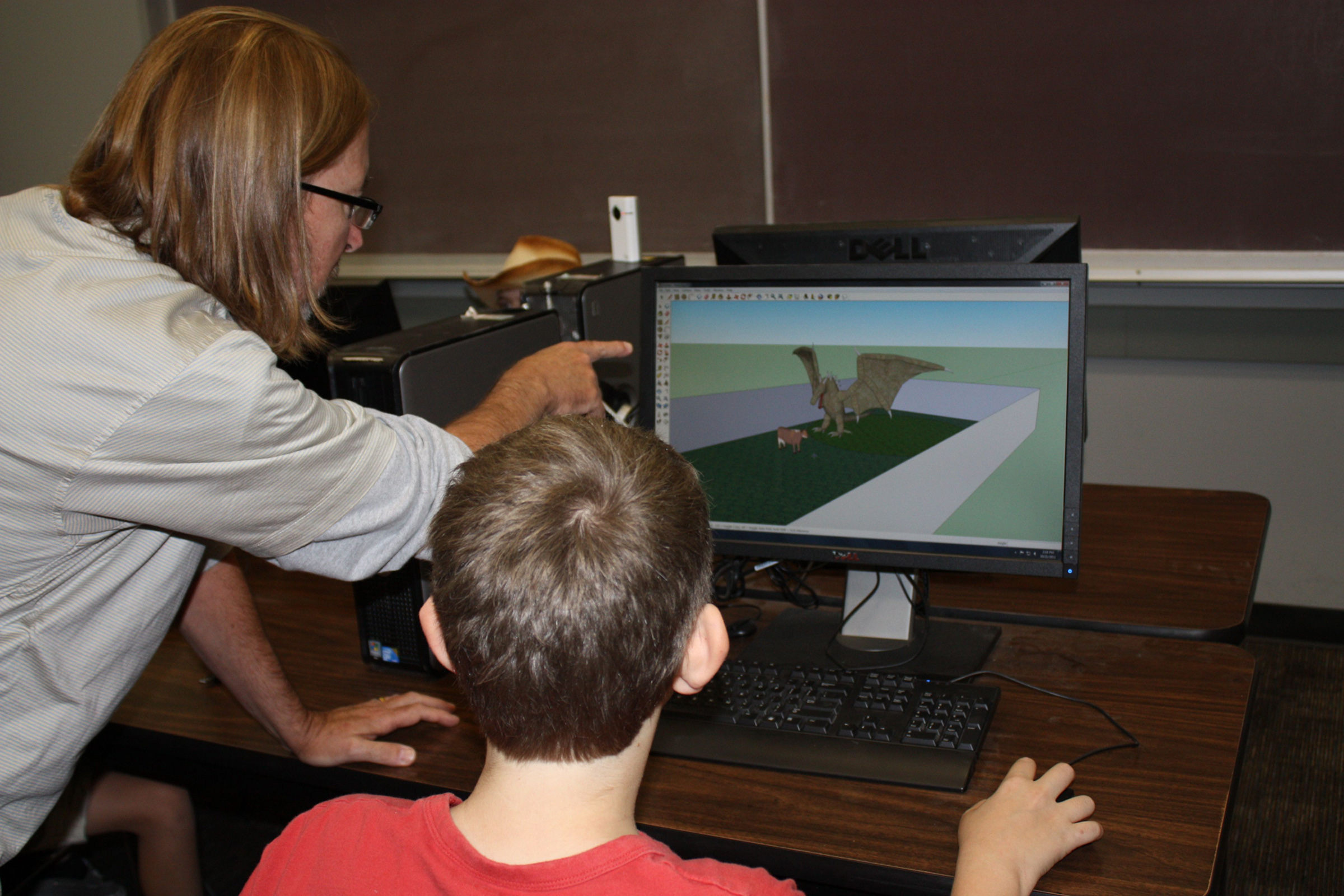 Steve Gross, certified SketchUp instructor, helps student tap into the technology at an iSTAR workshop for kids on the autism spectrum. Researchers found that for grandparents involved with their grandchildren in the workshops, new communication doors were opened between them.