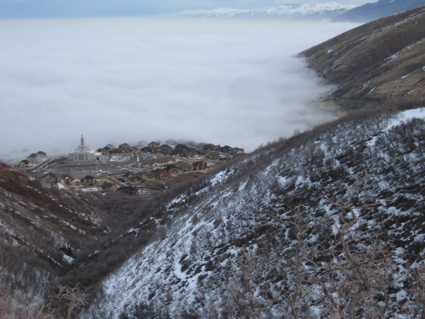 Polluted air in the Salt Lake Valley often is capped by fog, as is the case in this image of a temperature inversion holding cold, smoggy air close to the ground, just below the level of the Mormon church temple in Draper, Utah. University of Utah meteorologists are wrapping up two months of field measurements as part of a three-year, National Science Foundation-funded study of inversions and the weather conditions that promote them.