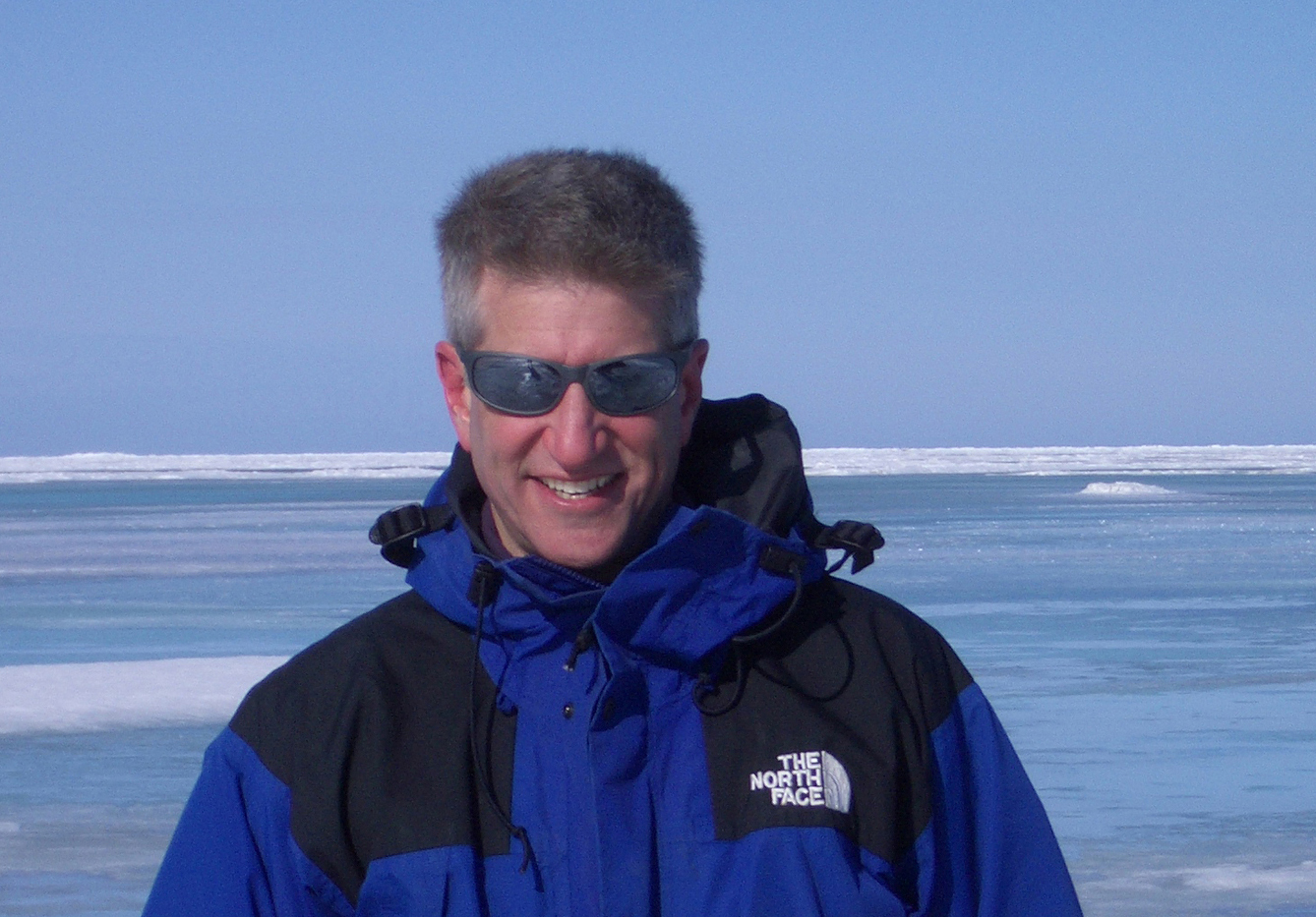 University of Utah mathematician Ken Golden stands in front of sea ice melt ponds in the Arctic near Barrow, Alaska. His research on sea ice's permeability to salt water promises to help improve forecasts of the effects of global warming.