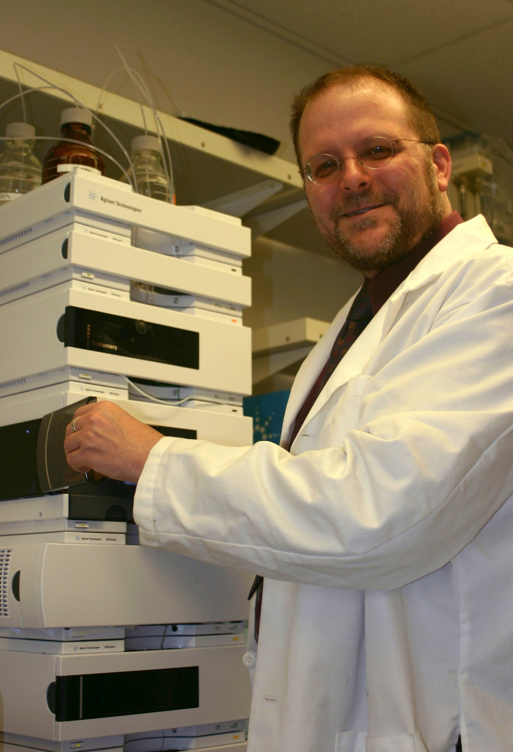 """University of Utah bioengineer Patrick Kiser analyzes polymers used to develop a new kind of AIDS-preventing vaginal gel for eventual use by women in Africa and other impoverished areas. The newly invented gel would be inserted a few hours before sex. During intercourse, polymers -- long, chain-like molecules -- within the gel become """"crosslinked,"""" forming a microscopic mesh that, in lab experiments, physically trapped HIV (human immunodeficiency virus) particles. That would prevent them from reaching and infecting vaginal cells."""