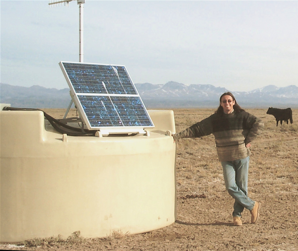 """University of Utah physicist Miguel Mostafa stands in Argentina by one of the Pierre Auger Observatory's 1,600 water tanks that detect """"air showers"""" of particles generated when incoming cosmic rays hit Earth's atmosphere. Mostafa and some other Utah physicists are part of a collaboration of scientists from 90 research institutions in 17 nations that studies cosmic rays using the Pierre Auger Observatory. In a new study, the scientists say that ultrahigh-energy cosmic rays -- the most energetic particles in the universe -- come from extremely violent, supermassive black holes in the centers, or nuclei, of certain galaxies."""