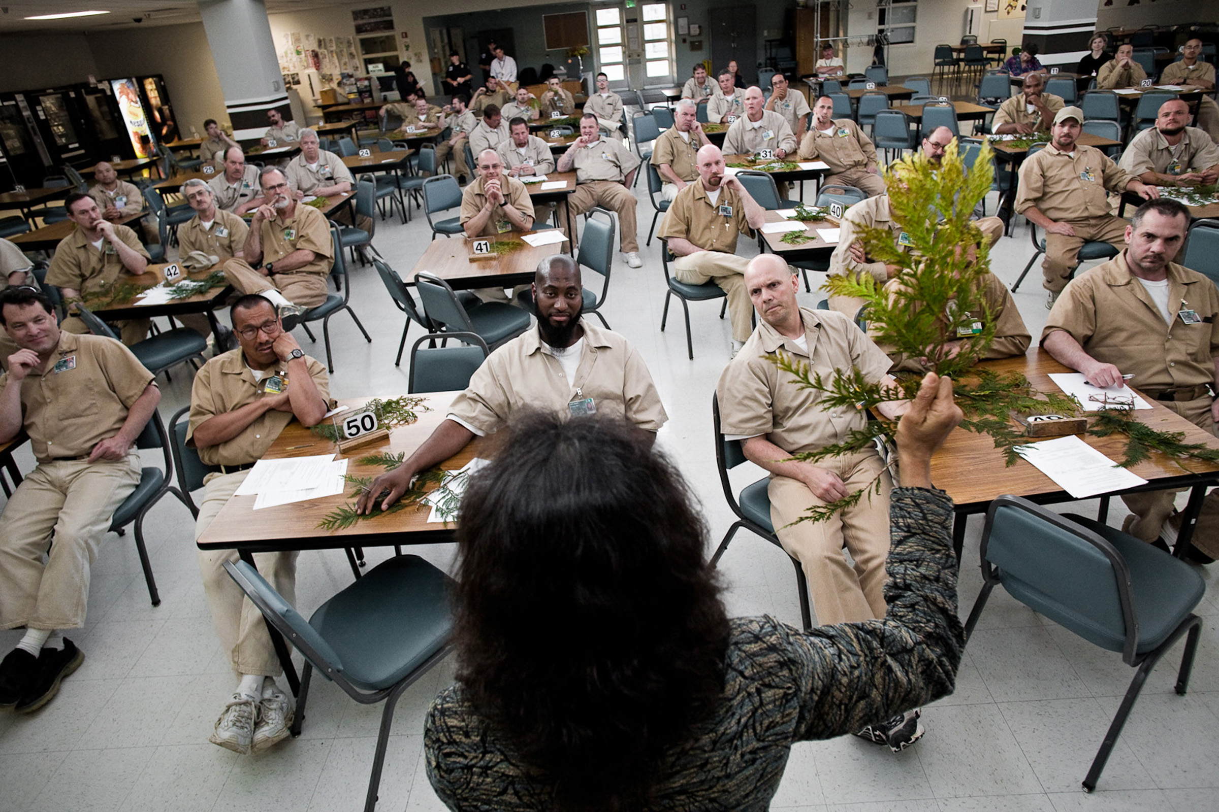 Biologist Nalini Nadkarni presents a lecture on trees to prison inmates in Washington state. Nalini, who now directs the University of Utah's Center for Science and Mathematics Education, is launching a similar project aimed at teaching science and environmental sustainability skills to prisoners in Utah.