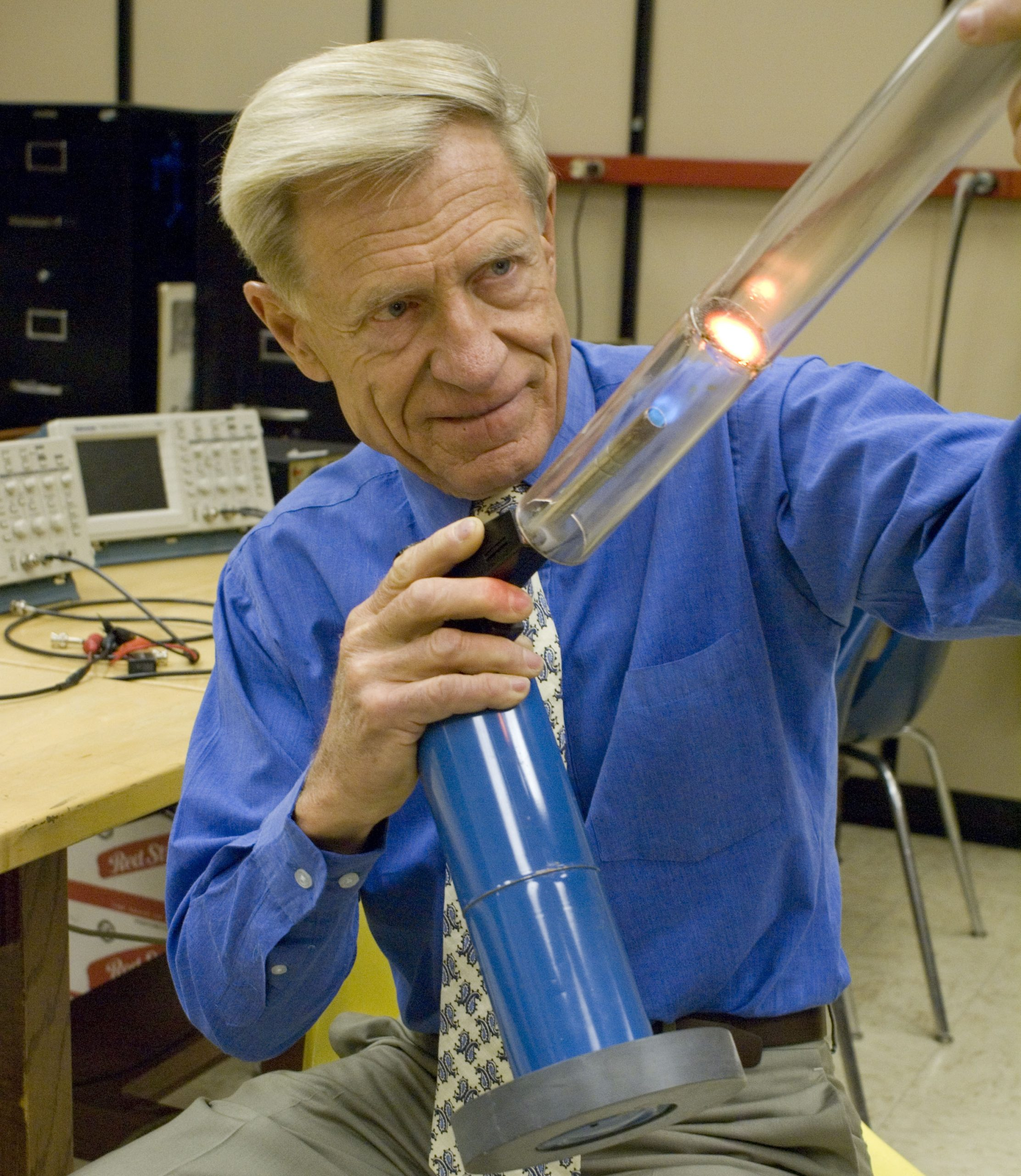 University of Utah physicist Orest Symko demonstrates how heat can be converted into sound by using a blowtorch to heat a metallic screen inside a plastic tube, which then produces a loud tone, similar to when air is blown into a flute. Symko and his students are developing much smaller devices that not only convert heat to sound, but then use the sound to generate electricity. The devices may be used to cool electronics, harness solar energy in a new way, and conserve energy by changing waste heat into electric power.